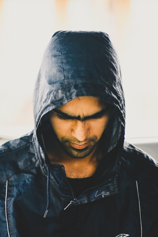 Man in Black Jacket While Looking Down