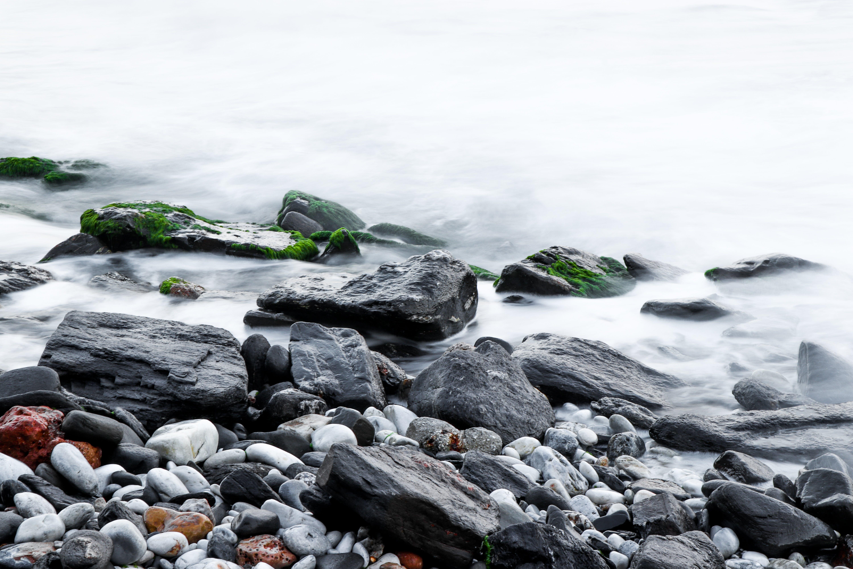 Brown Rock Beside Body of Water