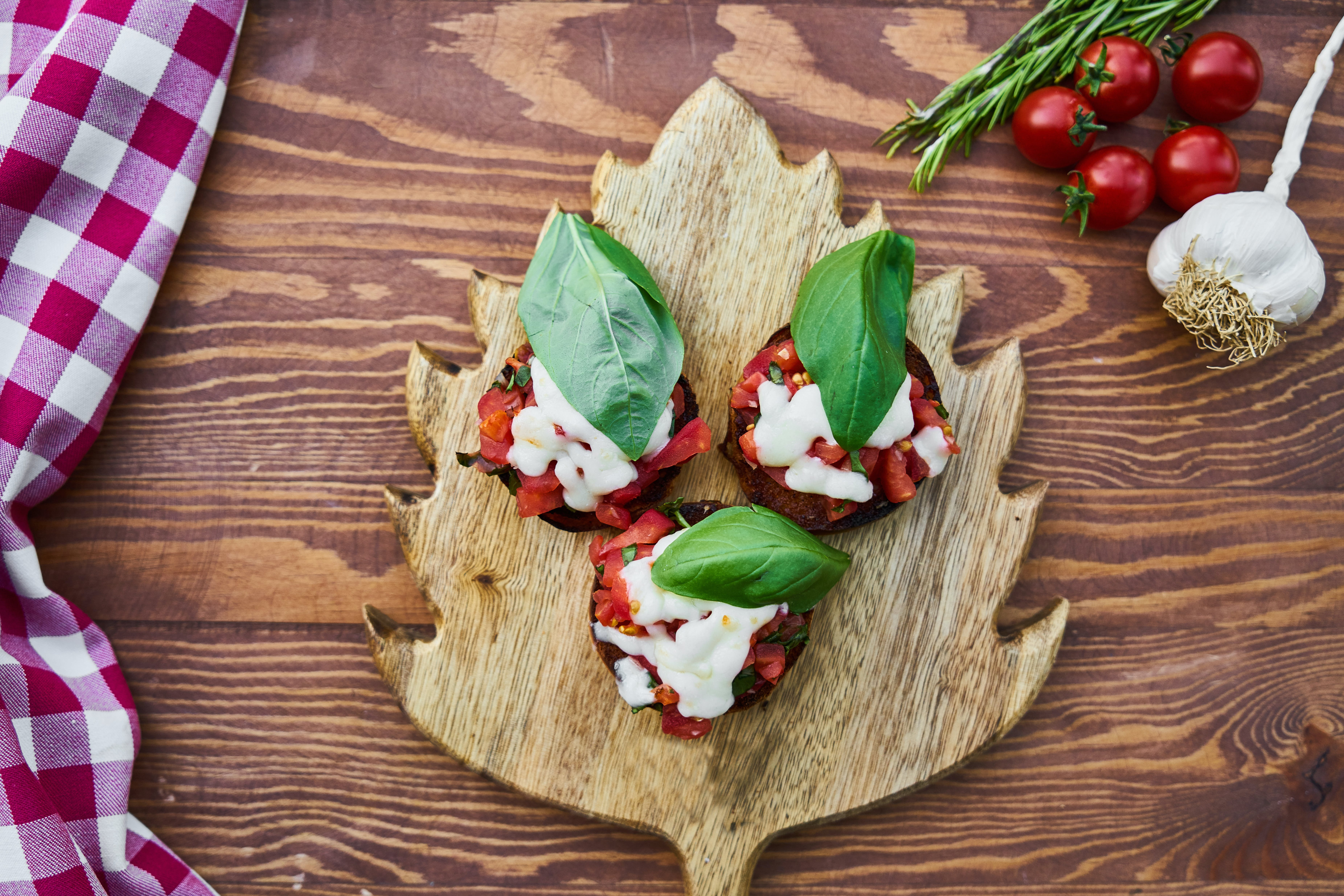 Three Tomato Dishes on Brown Wooden Chopping Board
