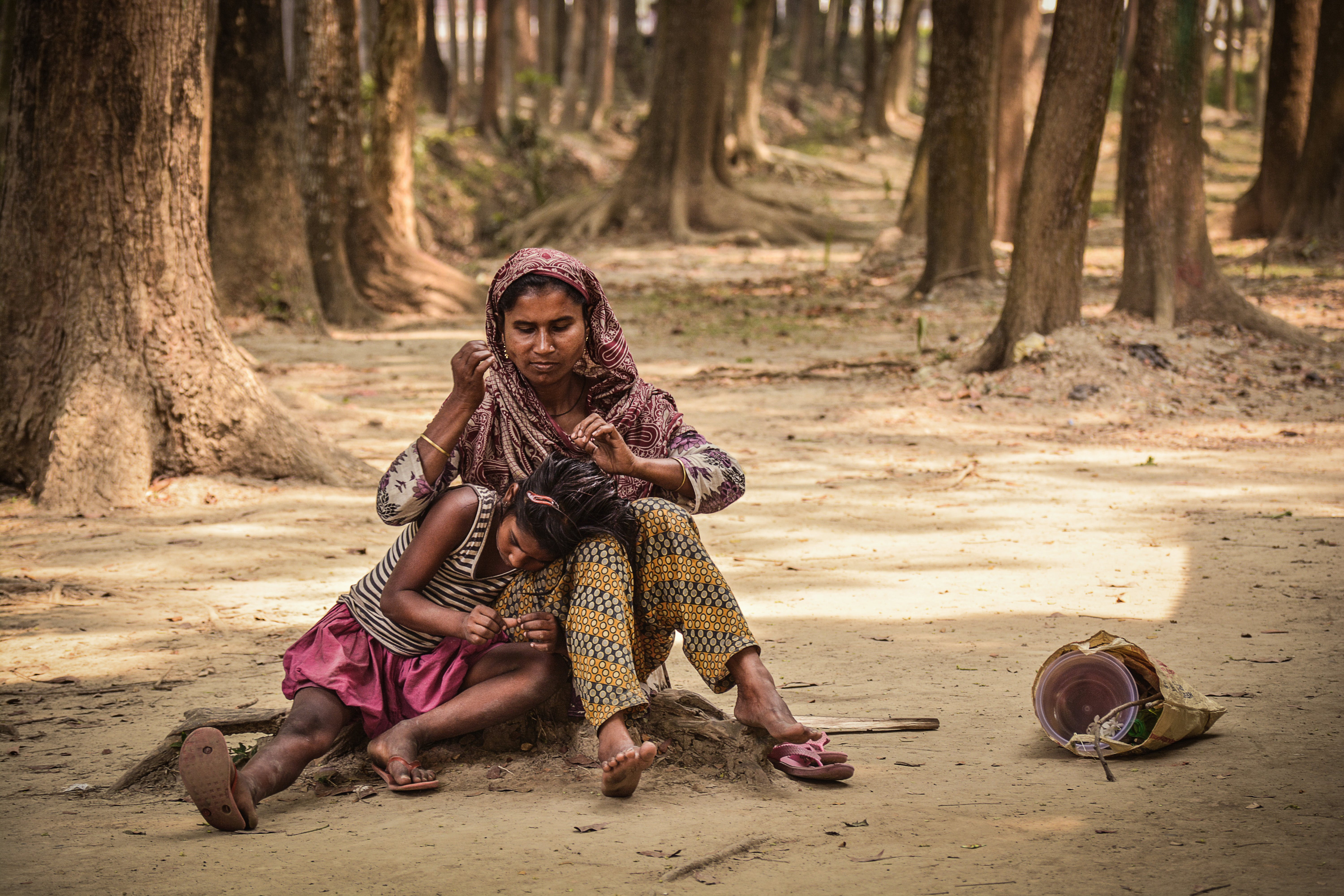 Woman and Girl Sitting on Ground