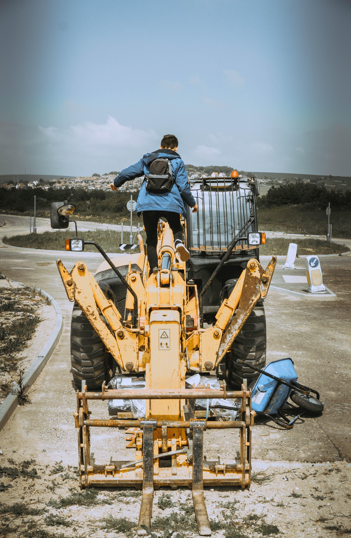 Man on Top of Excavator