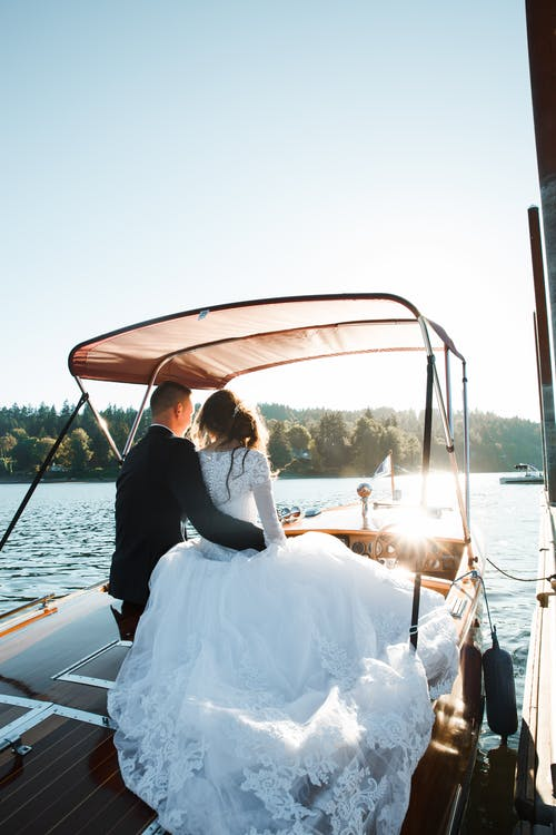 Wedded Couple Sitting on Motorboat