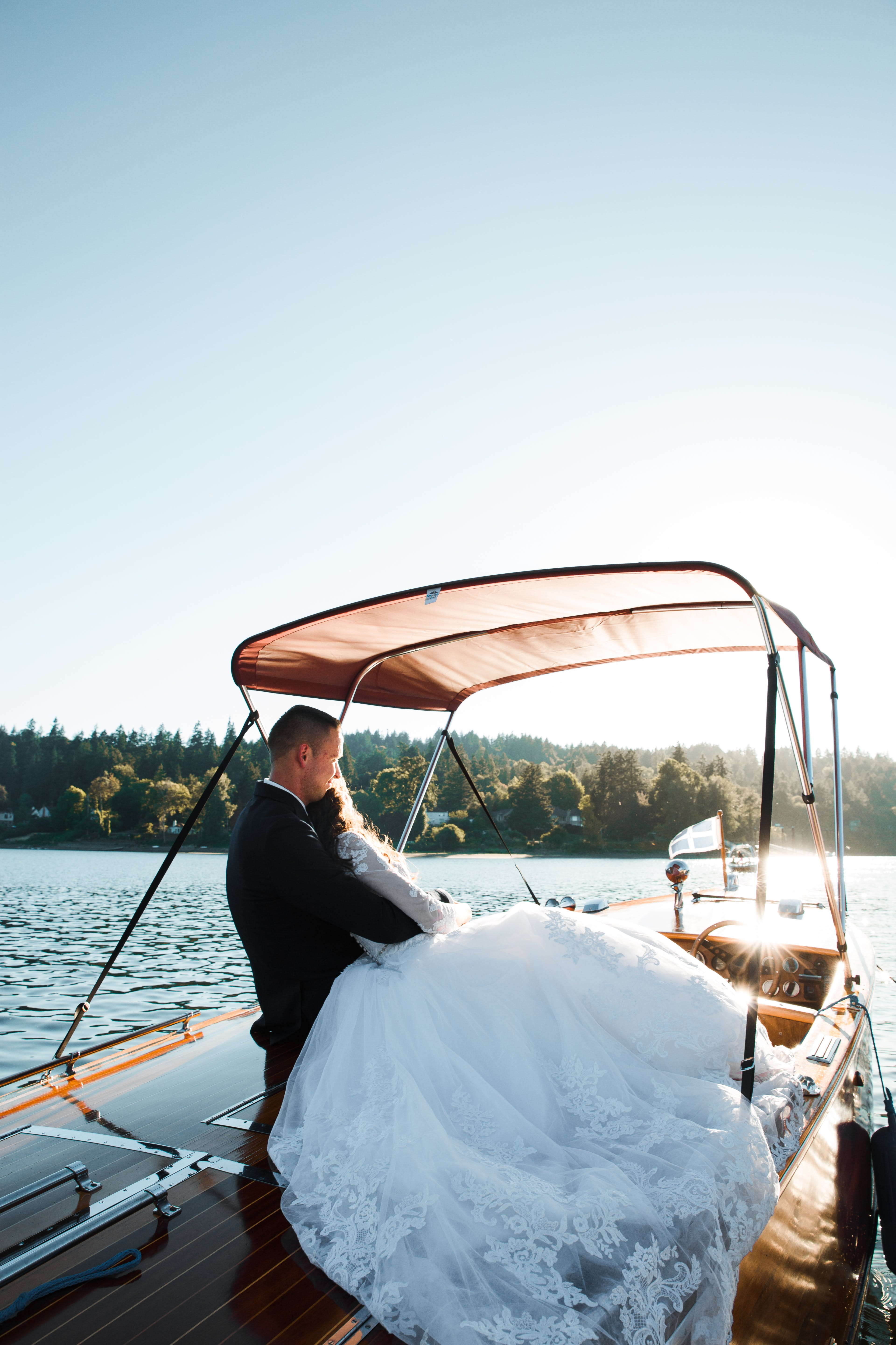 Bride and Groom Standing on Yacht