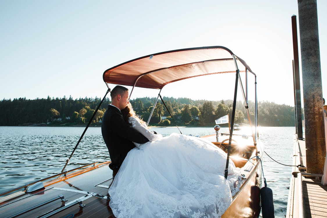 Bride and Groom Riding Powerboat