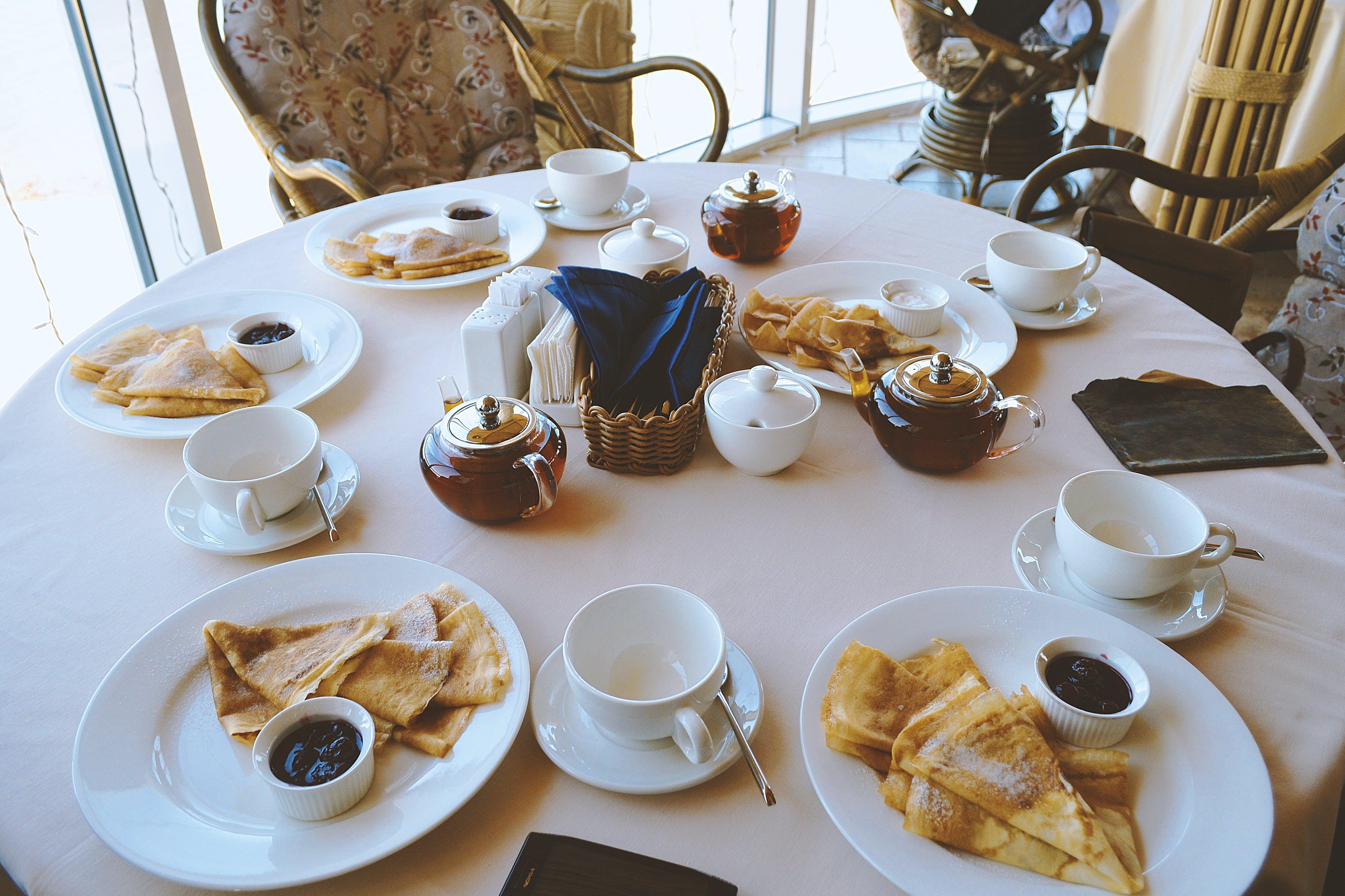 White Ceramic Dinnerware on Table