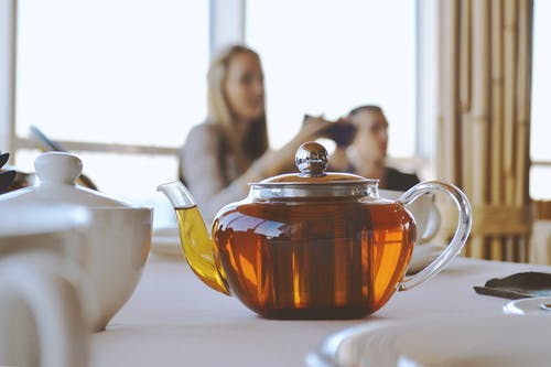 Clear Glass Teapot on White Table