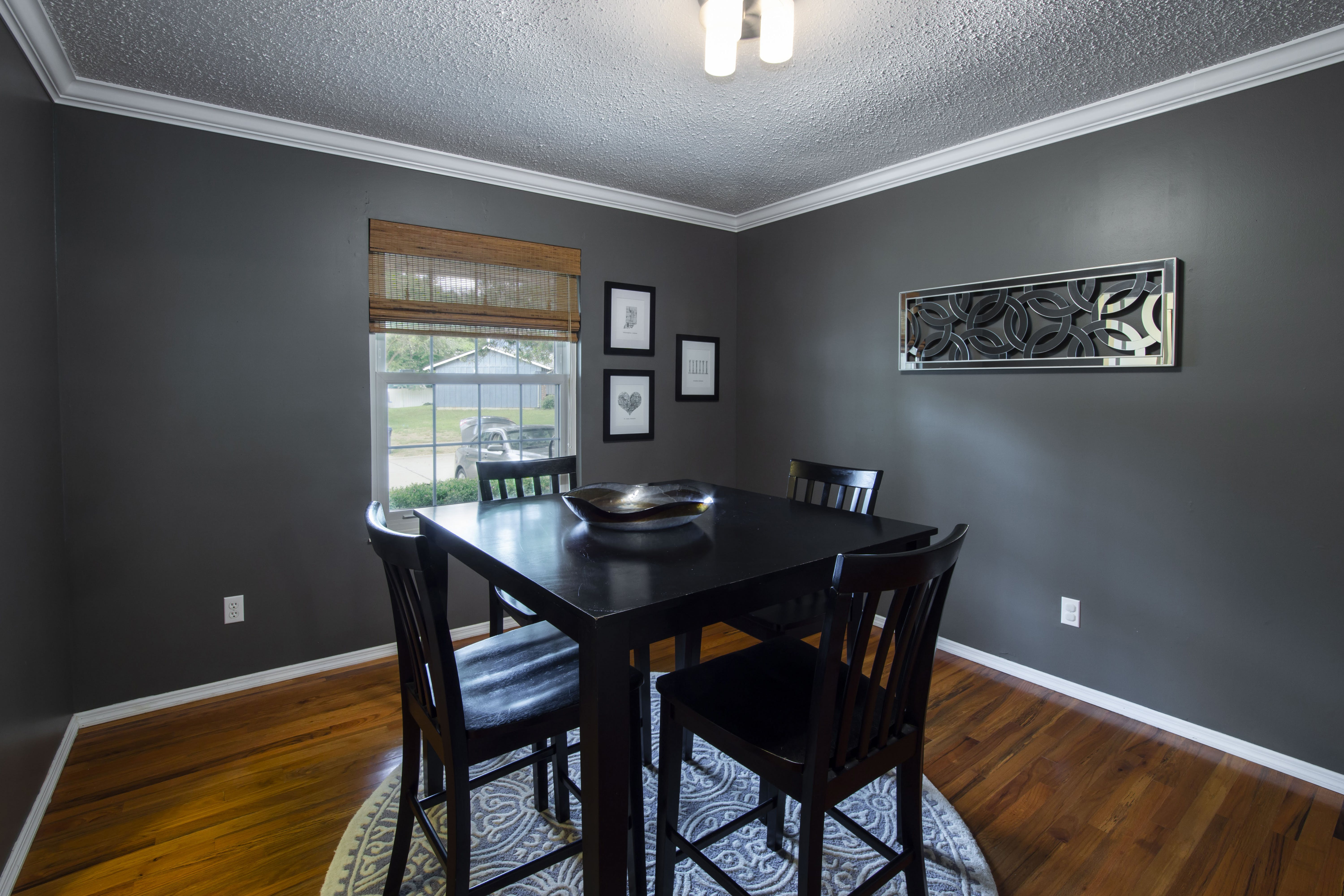 Black Wooden Table and Chairs Set