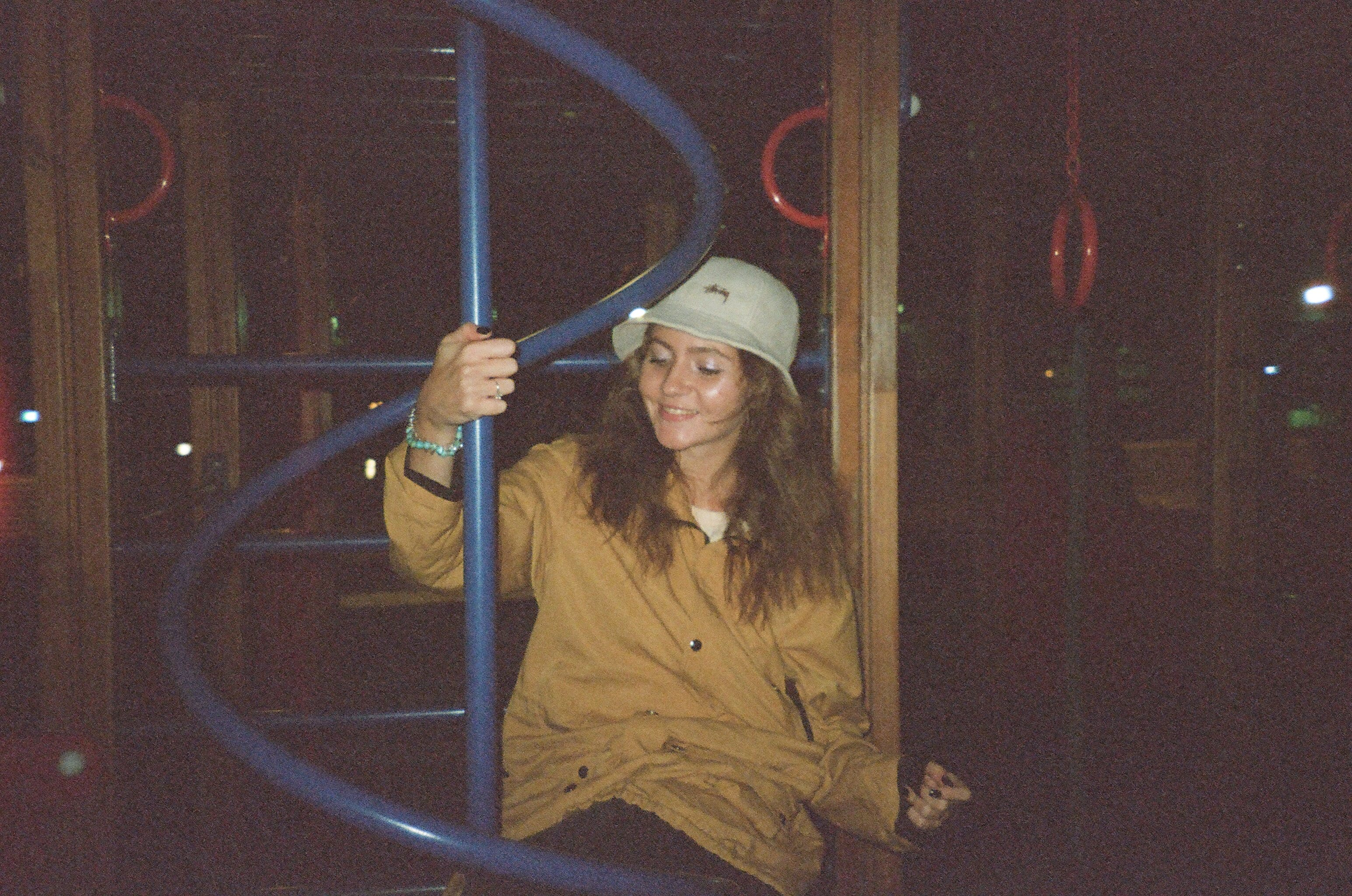 Woman Sitting on Blue Metal Playground