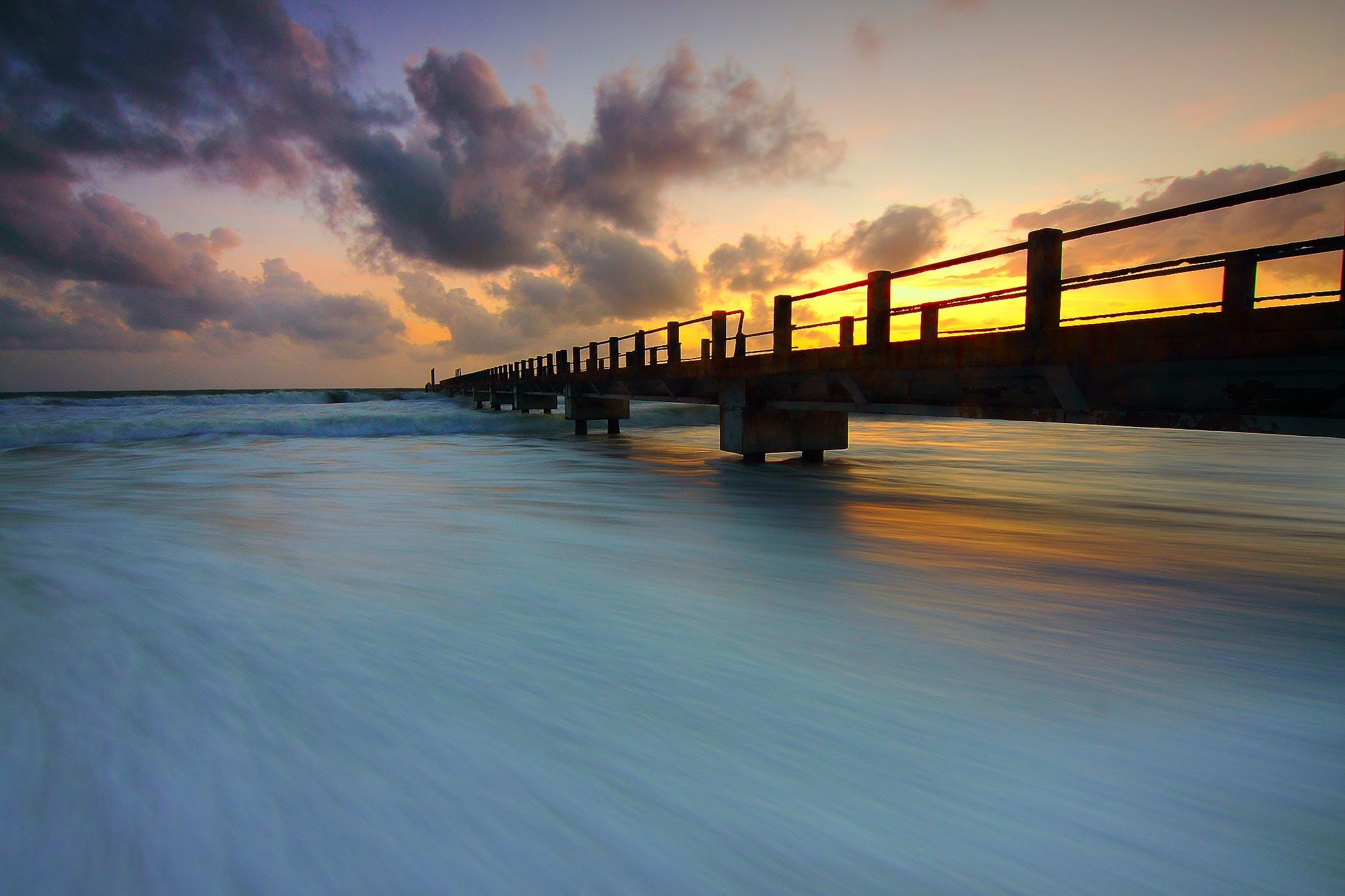 Wooden Pier on Ocean Waves