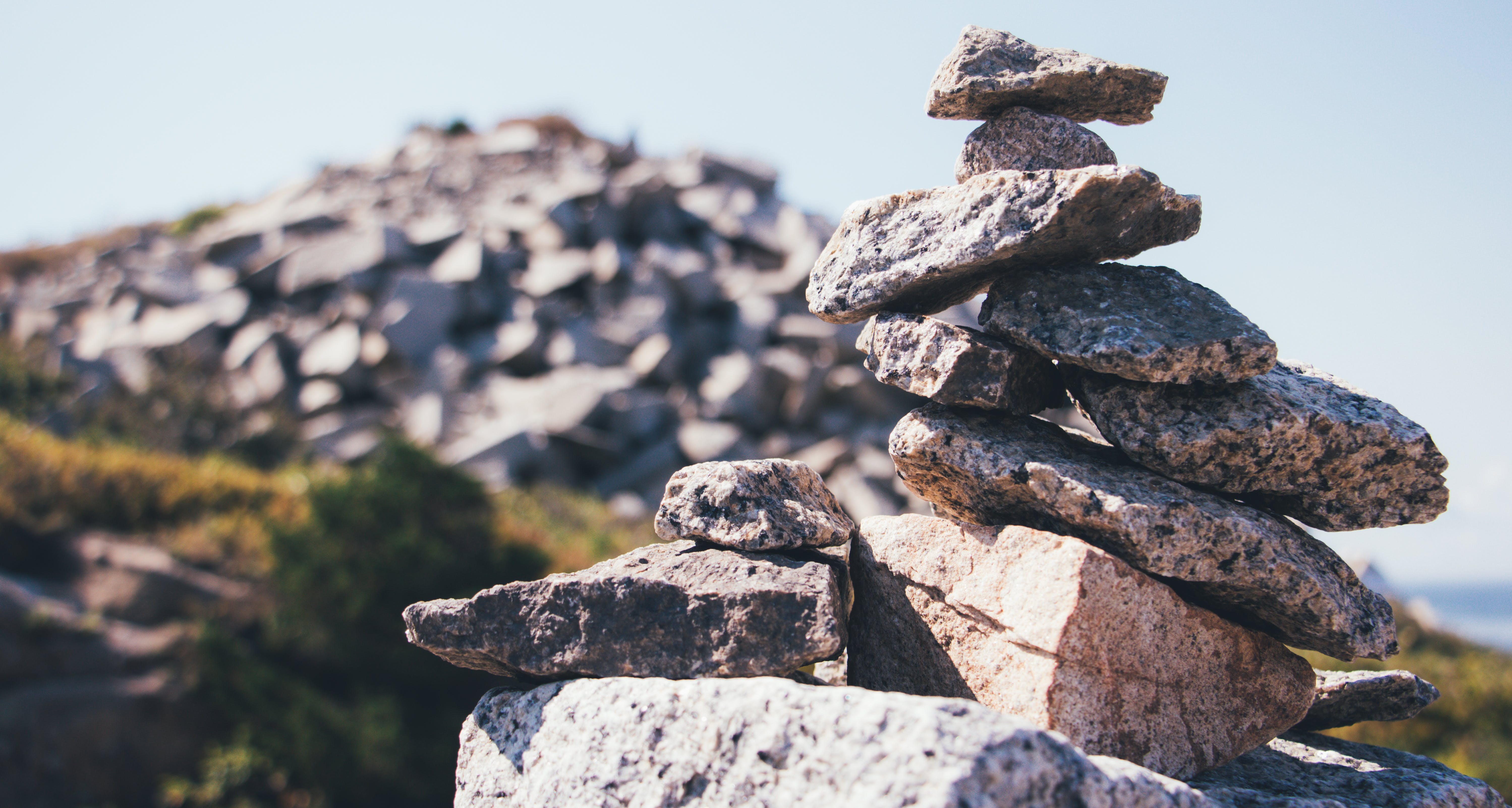 Selective Photo of Grey Stacked Stones