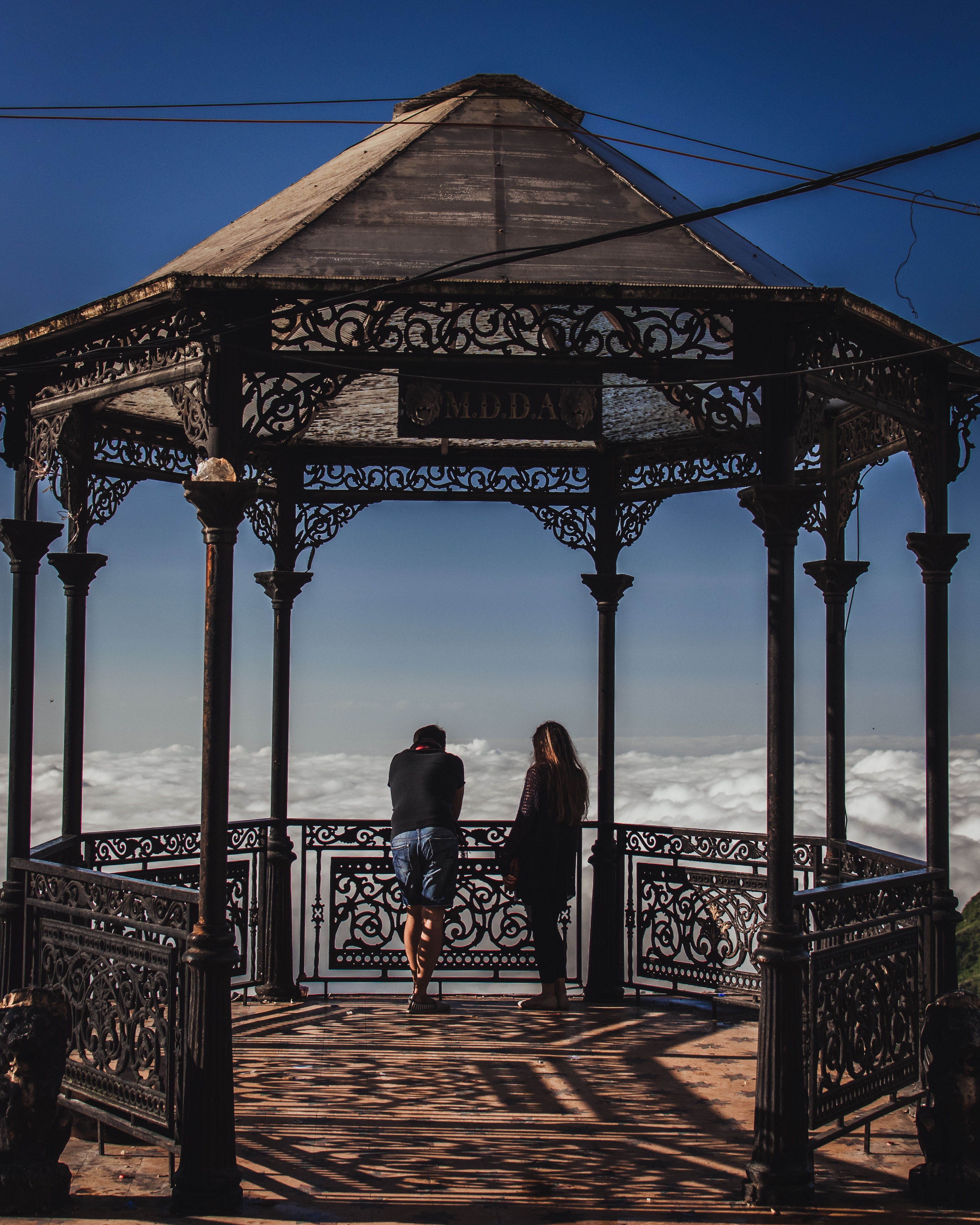 Man and Woman Inside Gray Gazebo