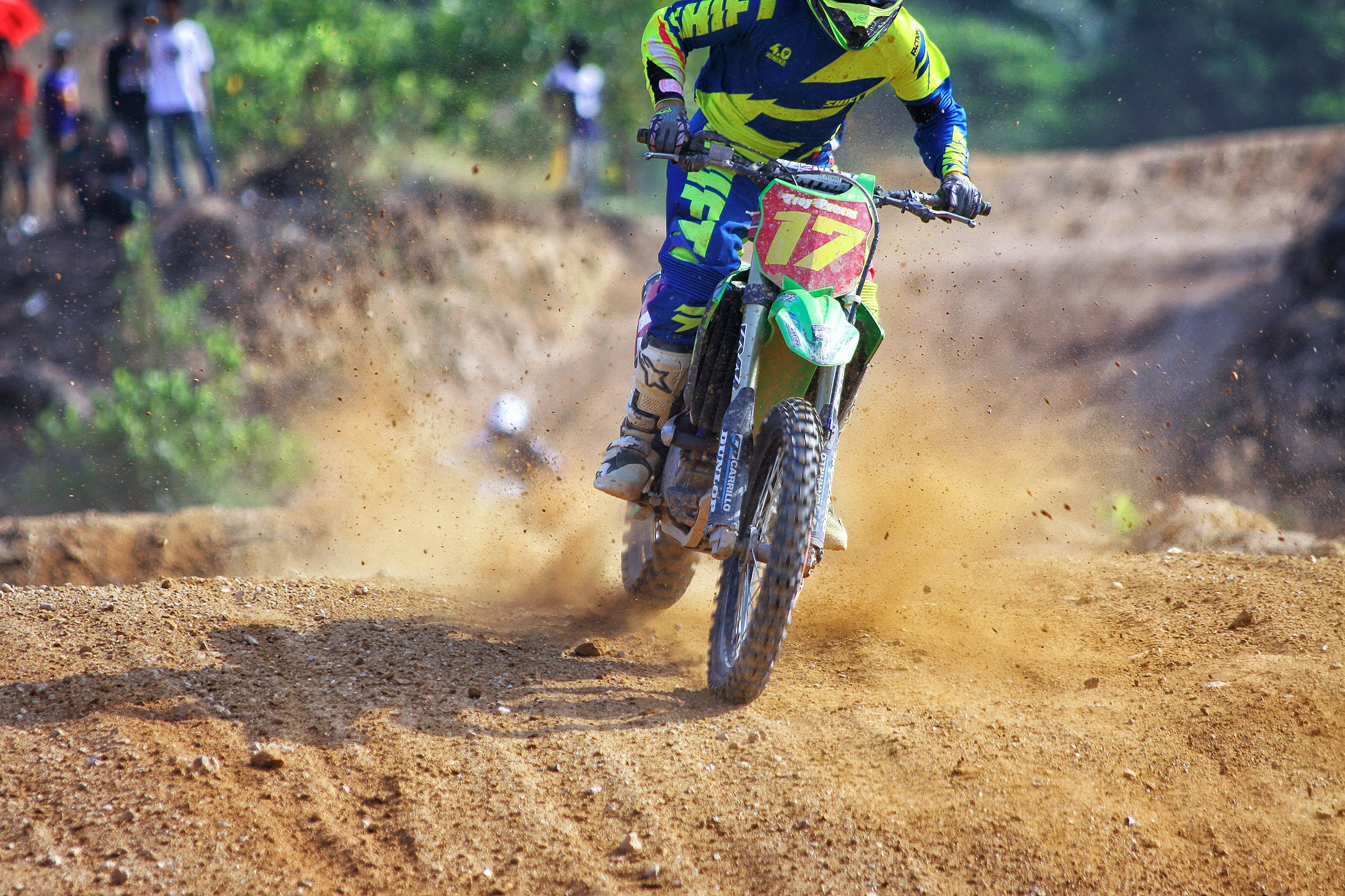 Man Riding Green Dirt Motorcycle during Daytime