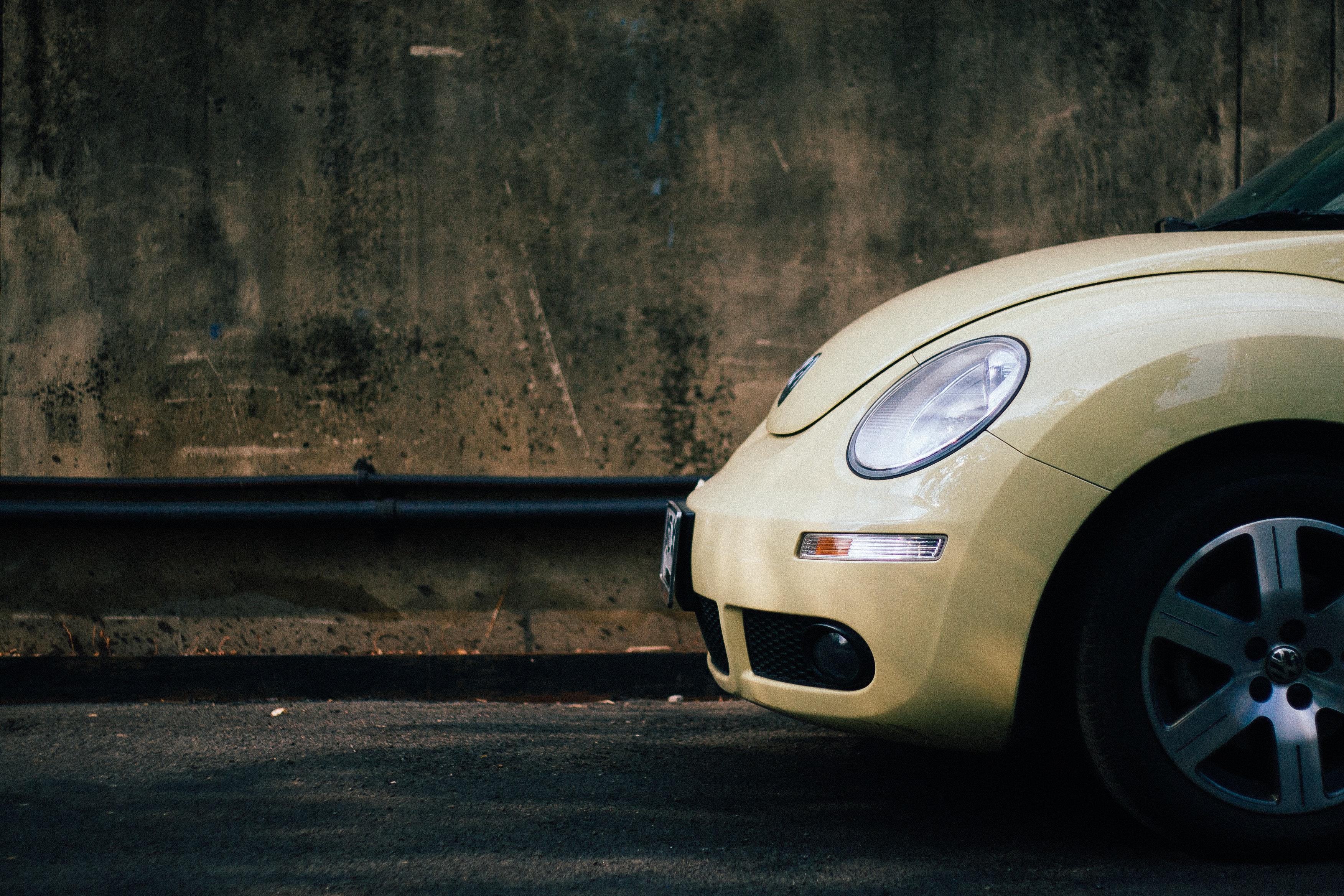 beige volkswagen beetle · free stock photo