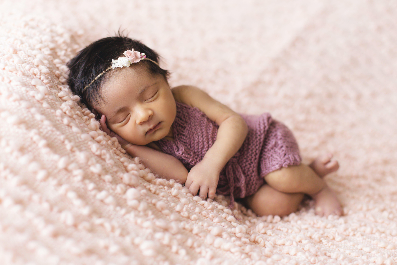 Toddler Lying on Pink Fleece Pad