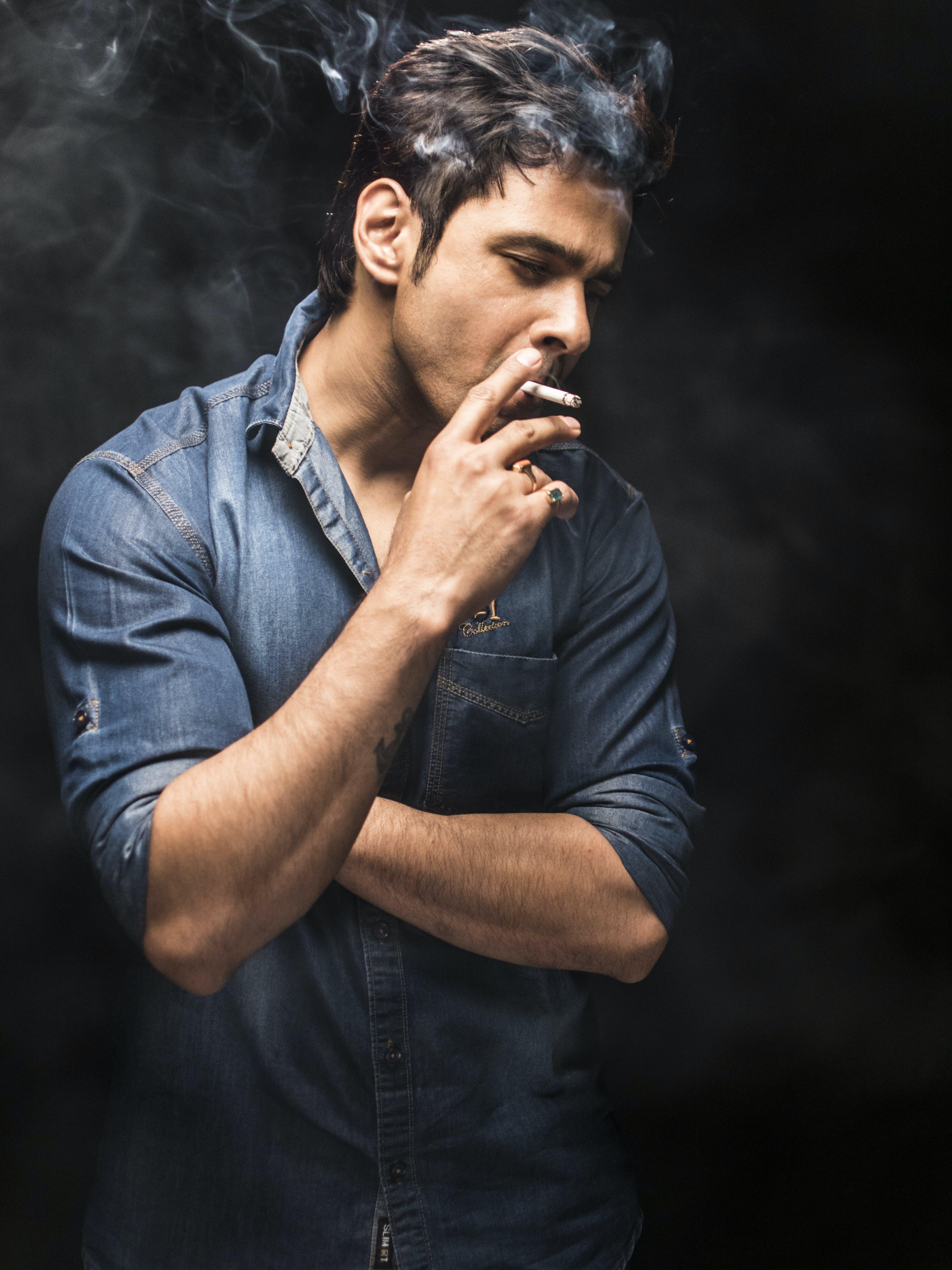 Man Smoking on Dark Background