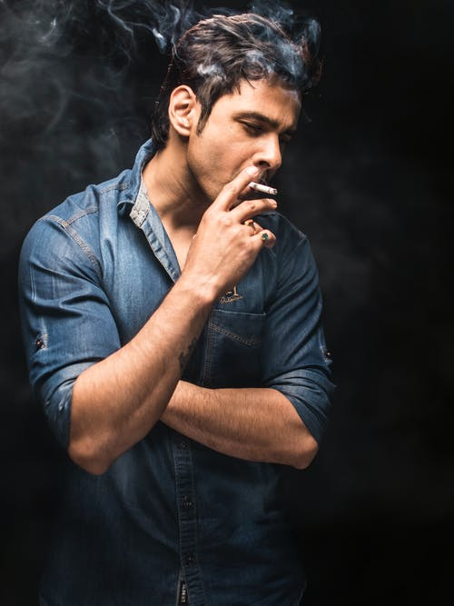 Man Smoking on Dark Background