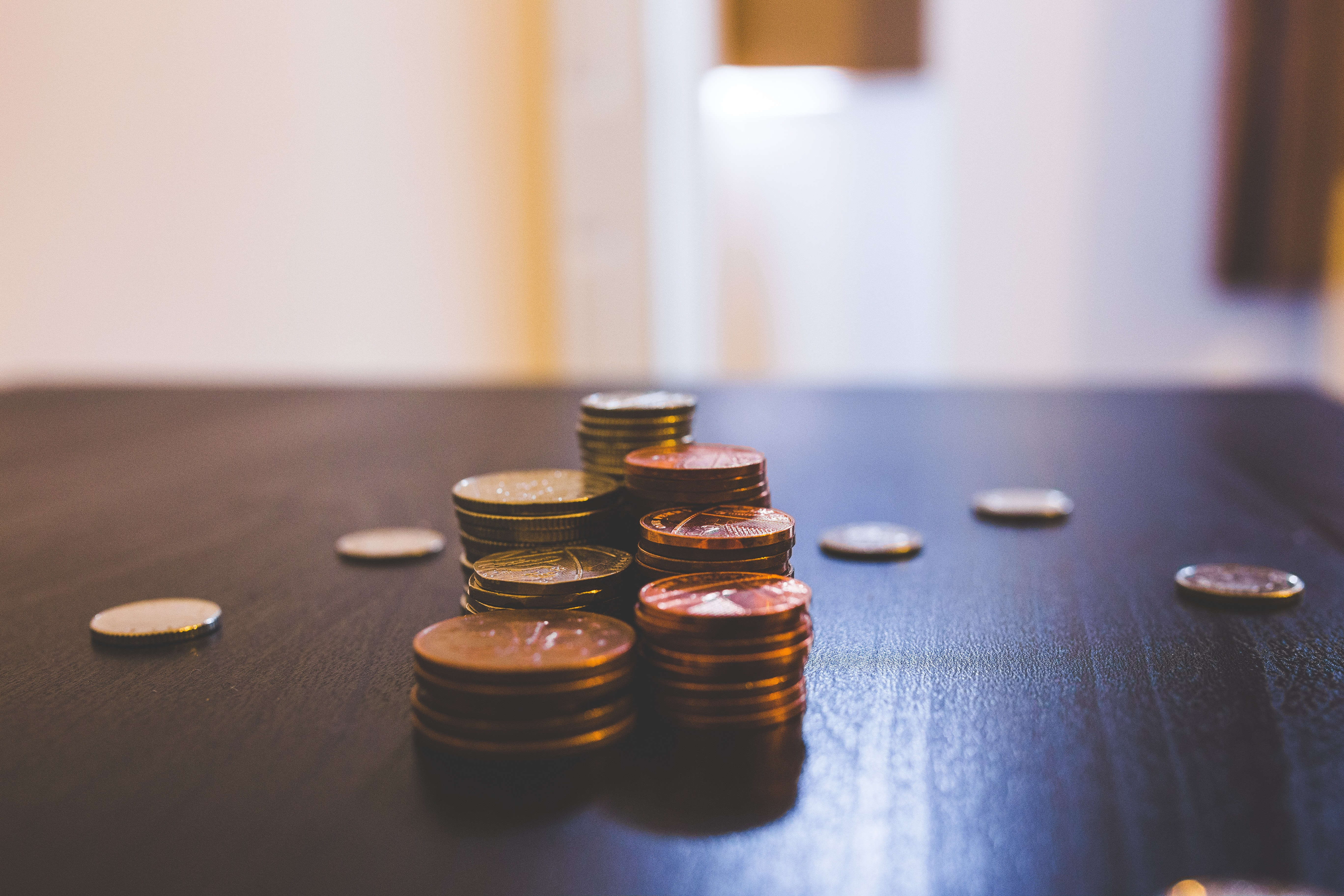 Pile of Brown Coins on Brown Wooden Table Top · Free Stock Photo