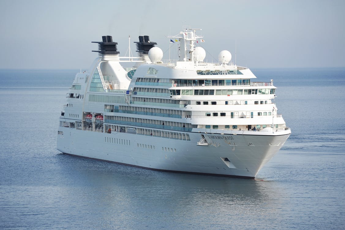 White Cruise Ship on Blue Body of Water during Daytime