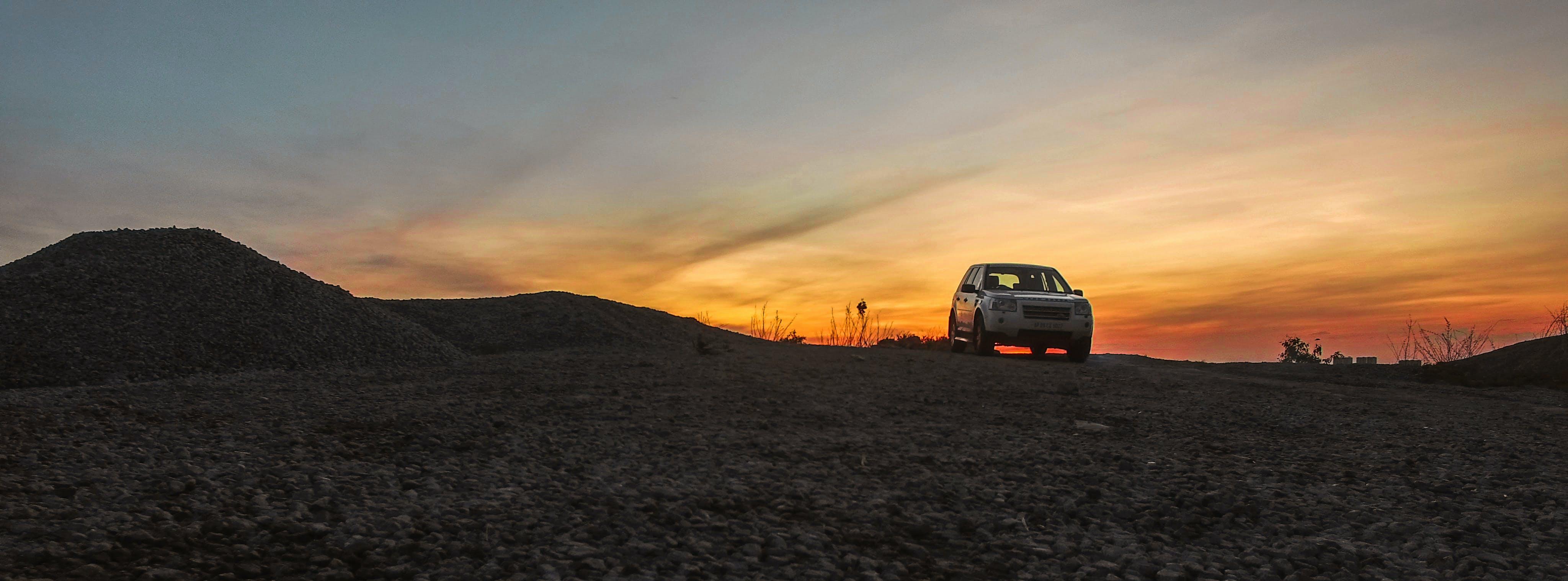 Free stock photo of car, golden sunset, land rover, landscape