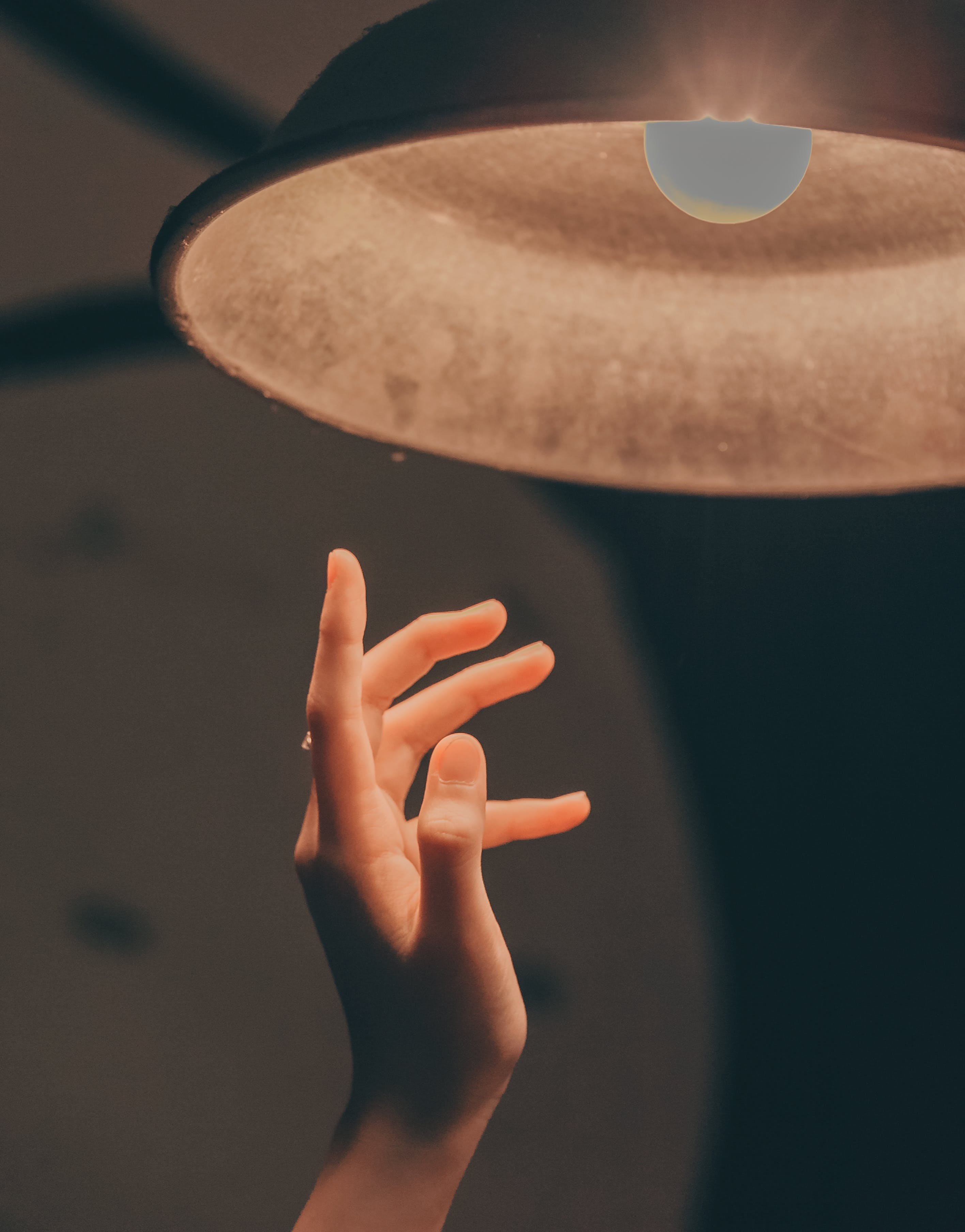 Person About to Touch the Pendant Lamp