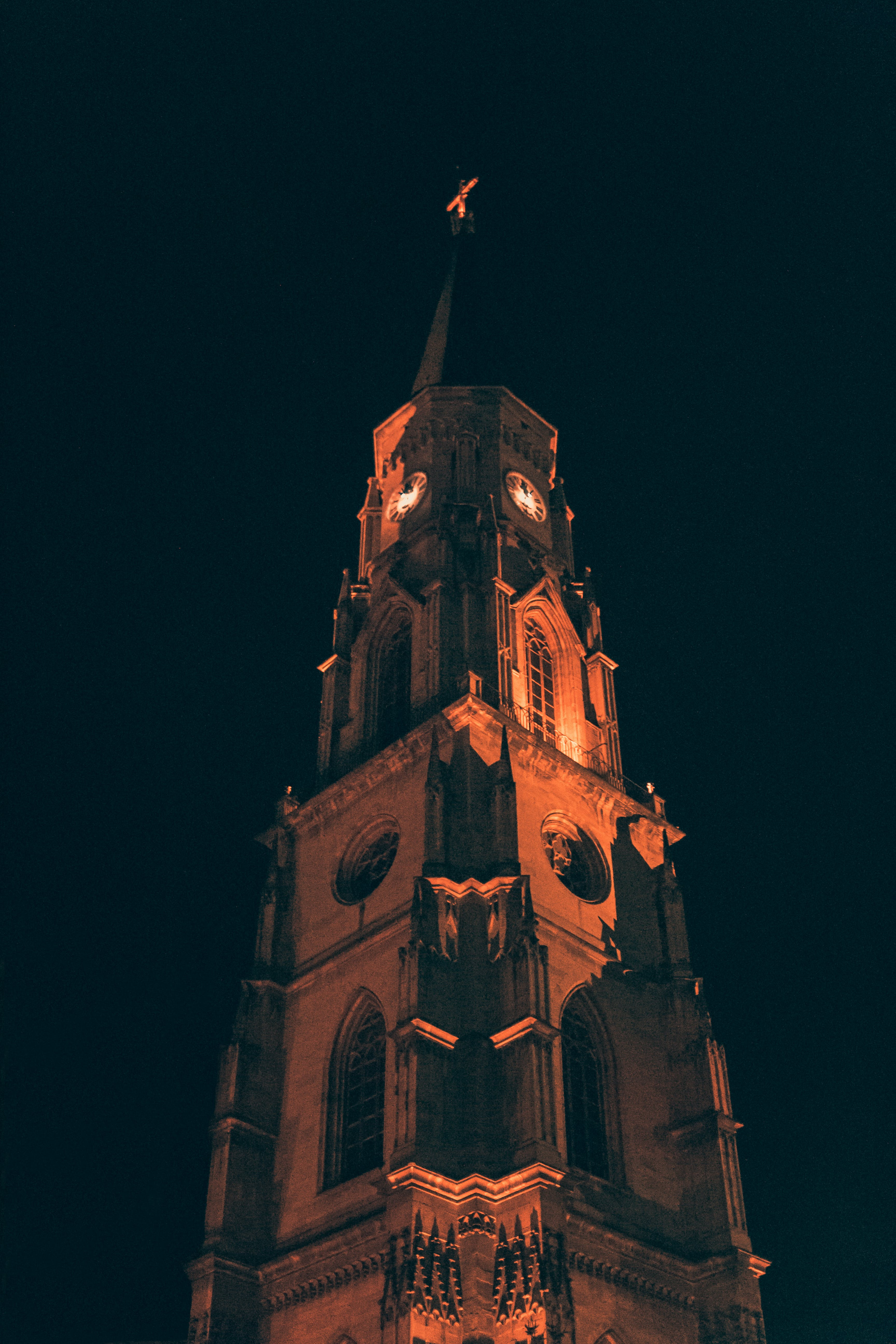 Brown Concrete Tower at Night Time