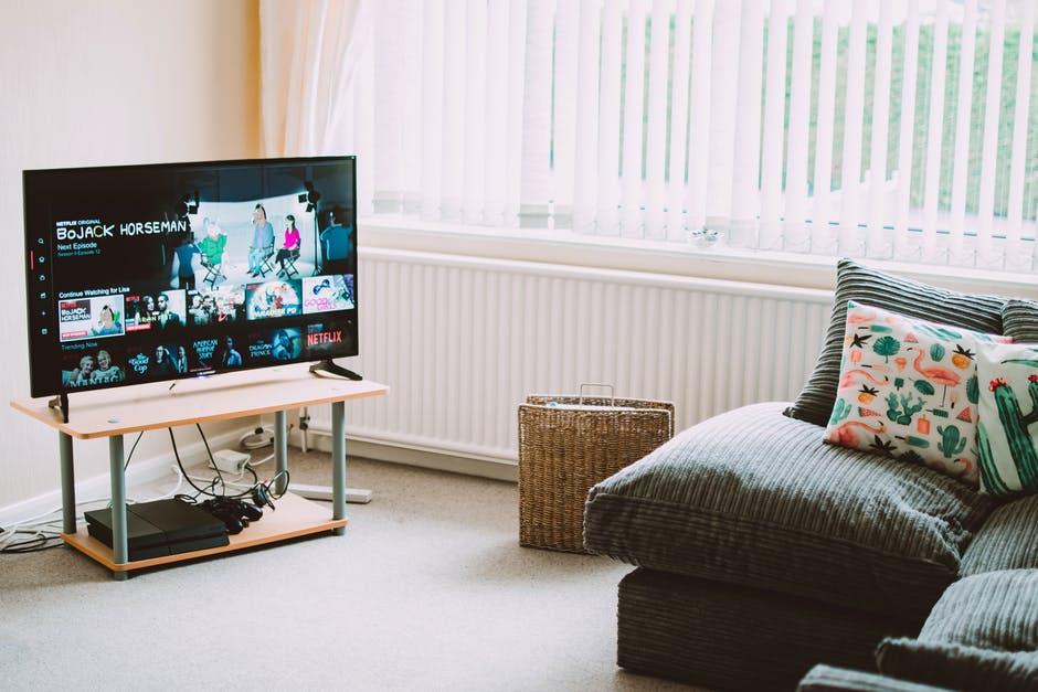 Turned-on Flat Screen Smart Television Ahead