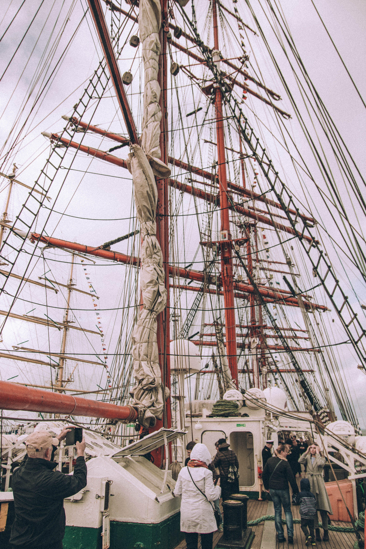 People Near White Sailship