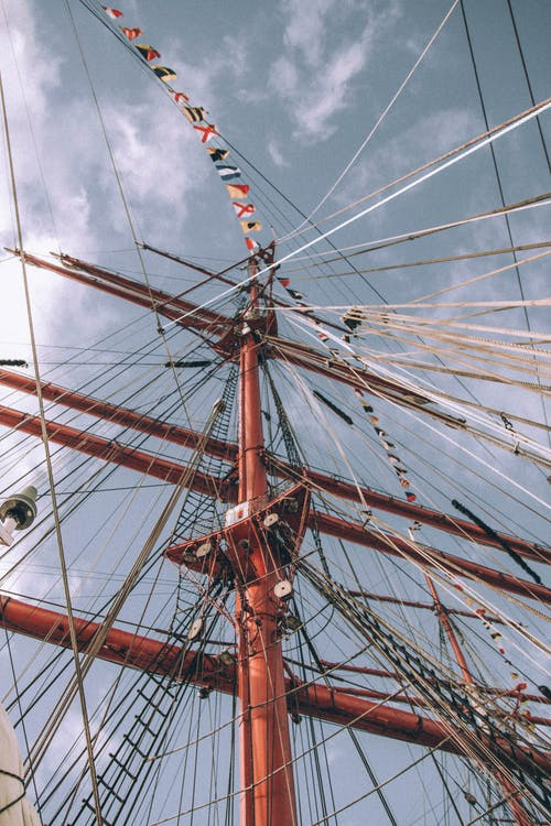 Mast of sailing ship backing up with guy lines