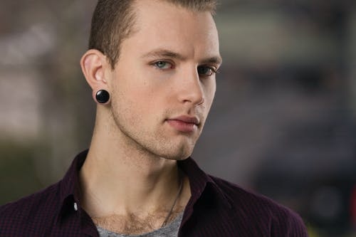 Man Wearing Maroon Collared Shirt