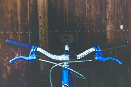 Blue and Black Bicycle Handle Bar