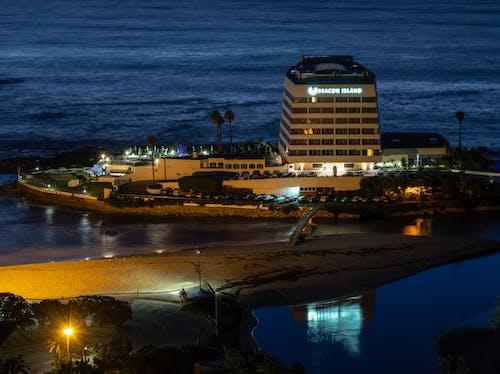 Бесплатное стоковое фото с апельсин, берег, вечер, вода