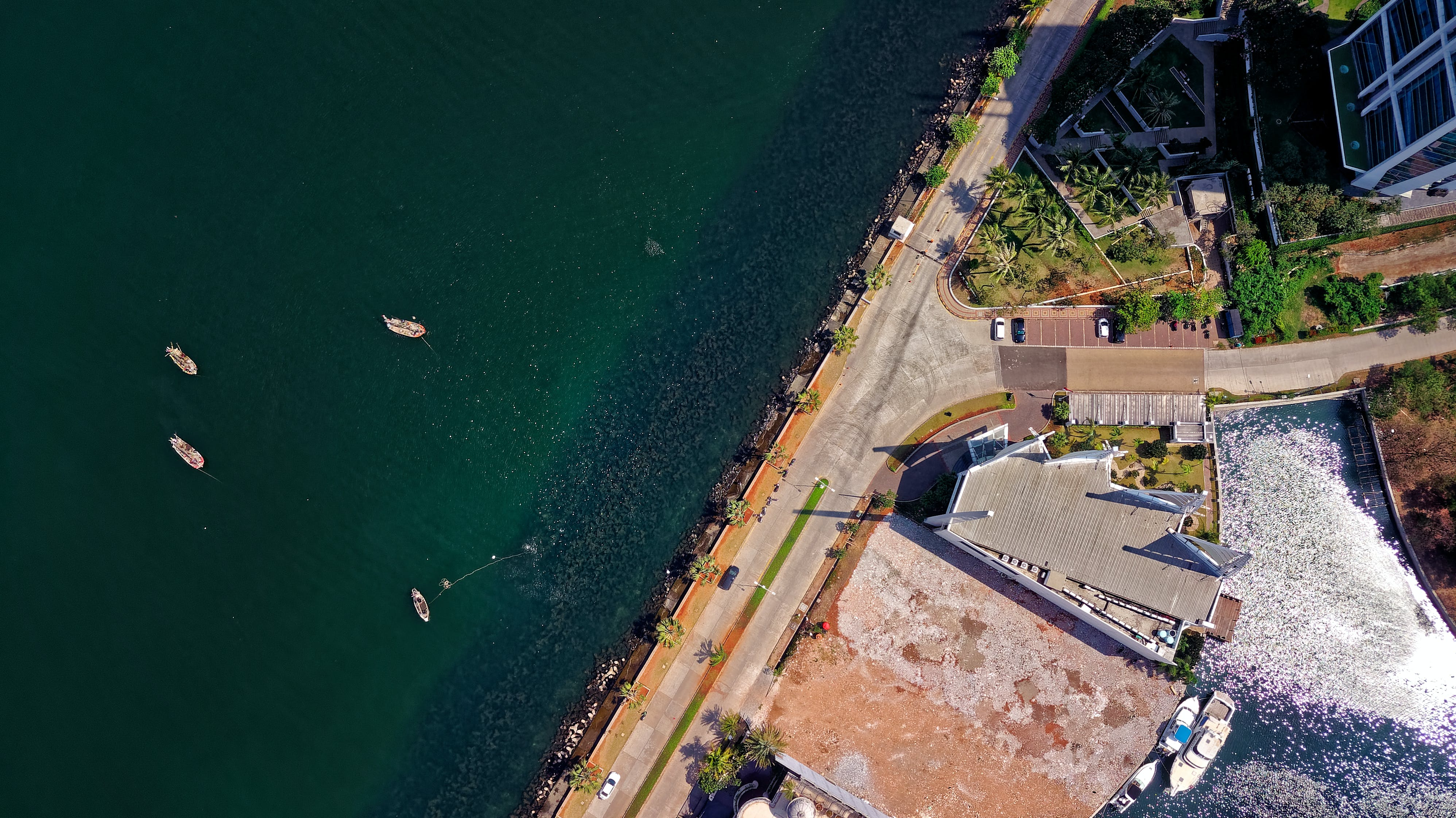 Aerial Photography of Building Near Body of Water