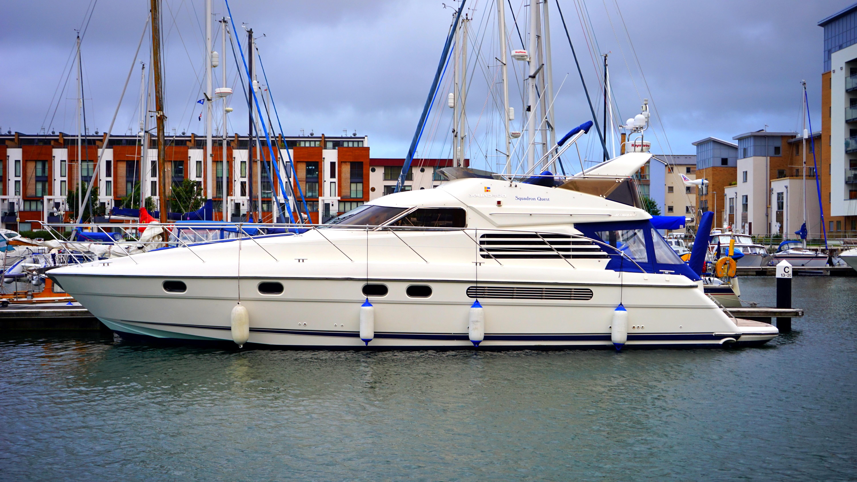 White Yacht Docked on Port