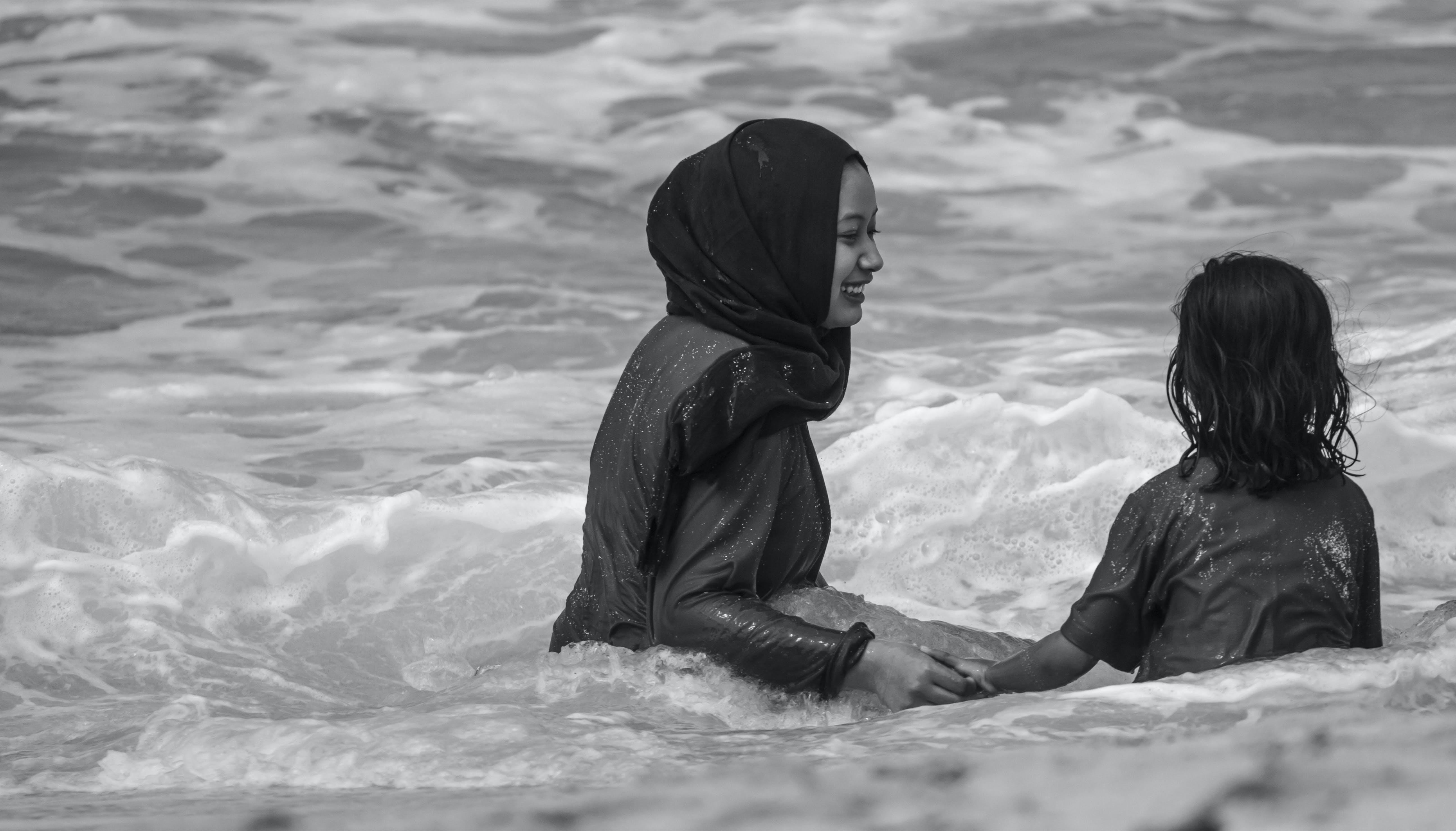 Free stock photo of beach, black-and-white, smile, street photo