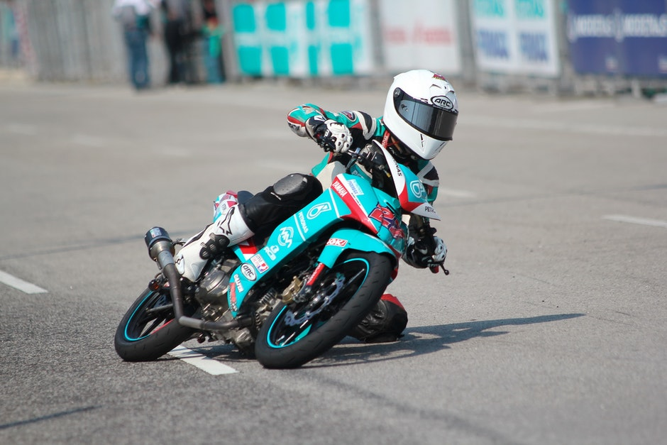 Biker Riding a Teal Sport Bike