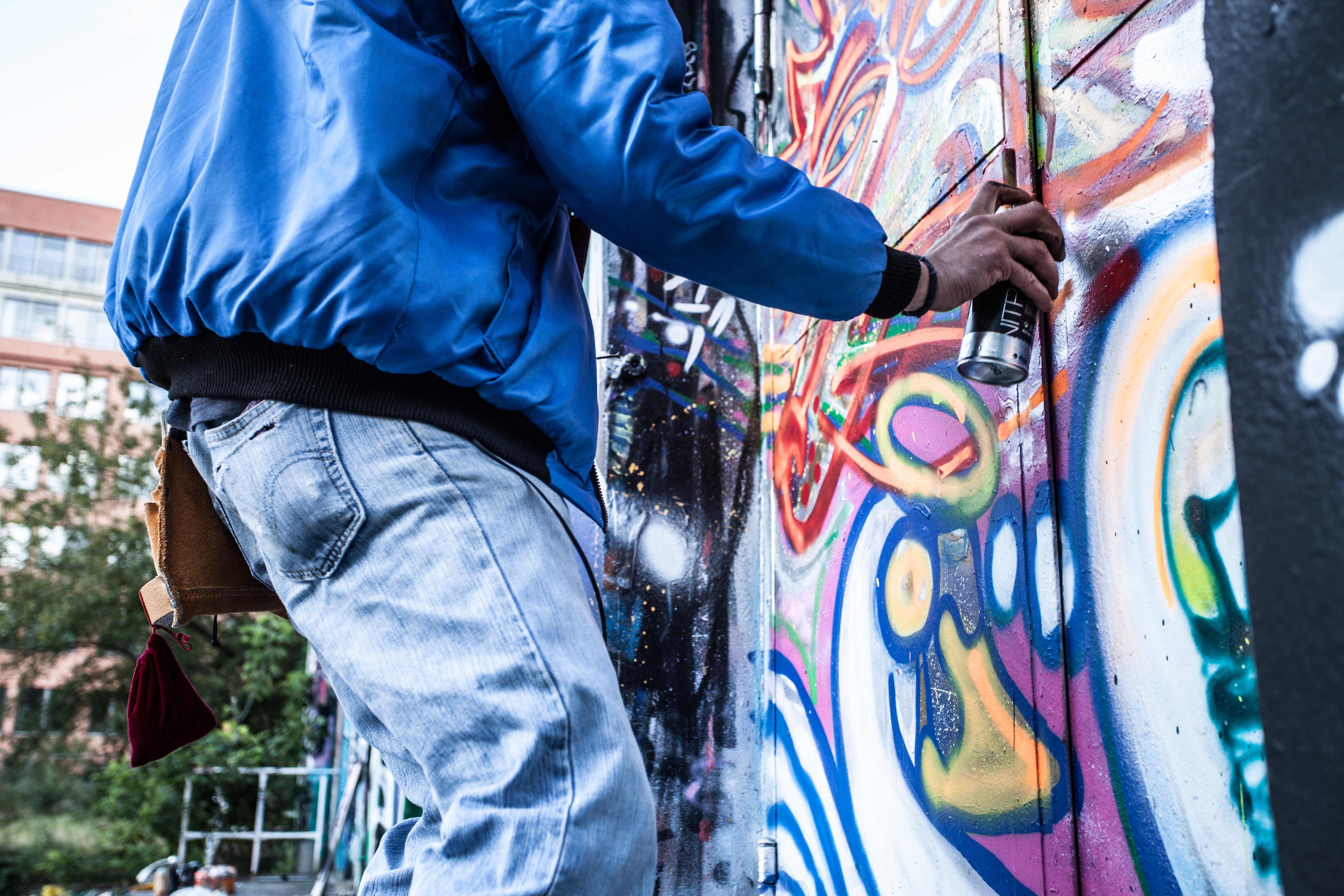 Photo of Person Painting Graffiti