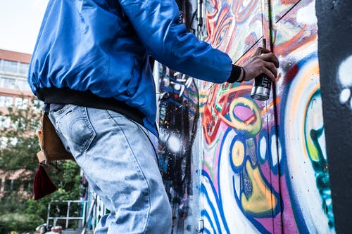 Photo of Person Painting Graffiti