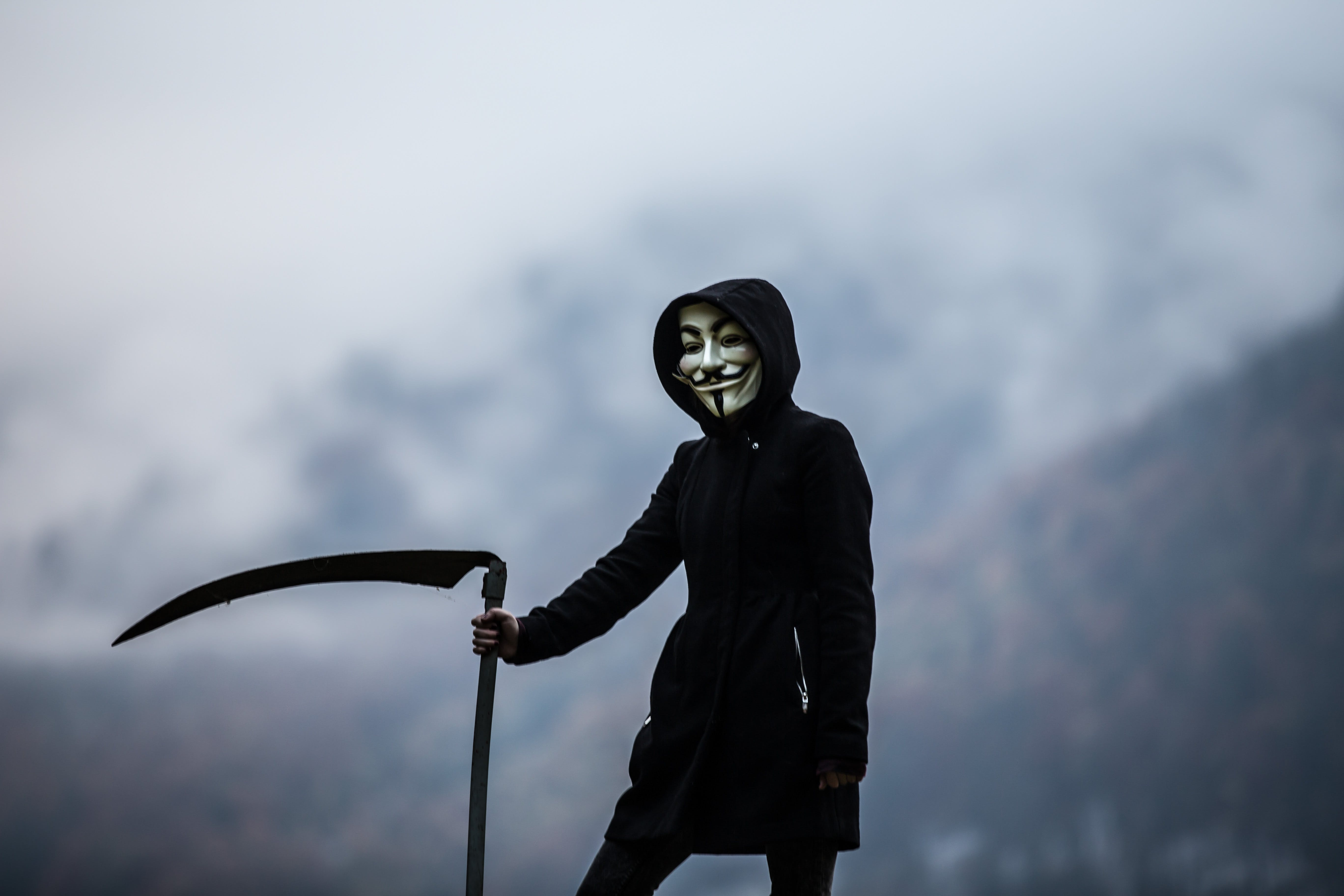 Photo of Person Wearing Guy Fawkes Mask