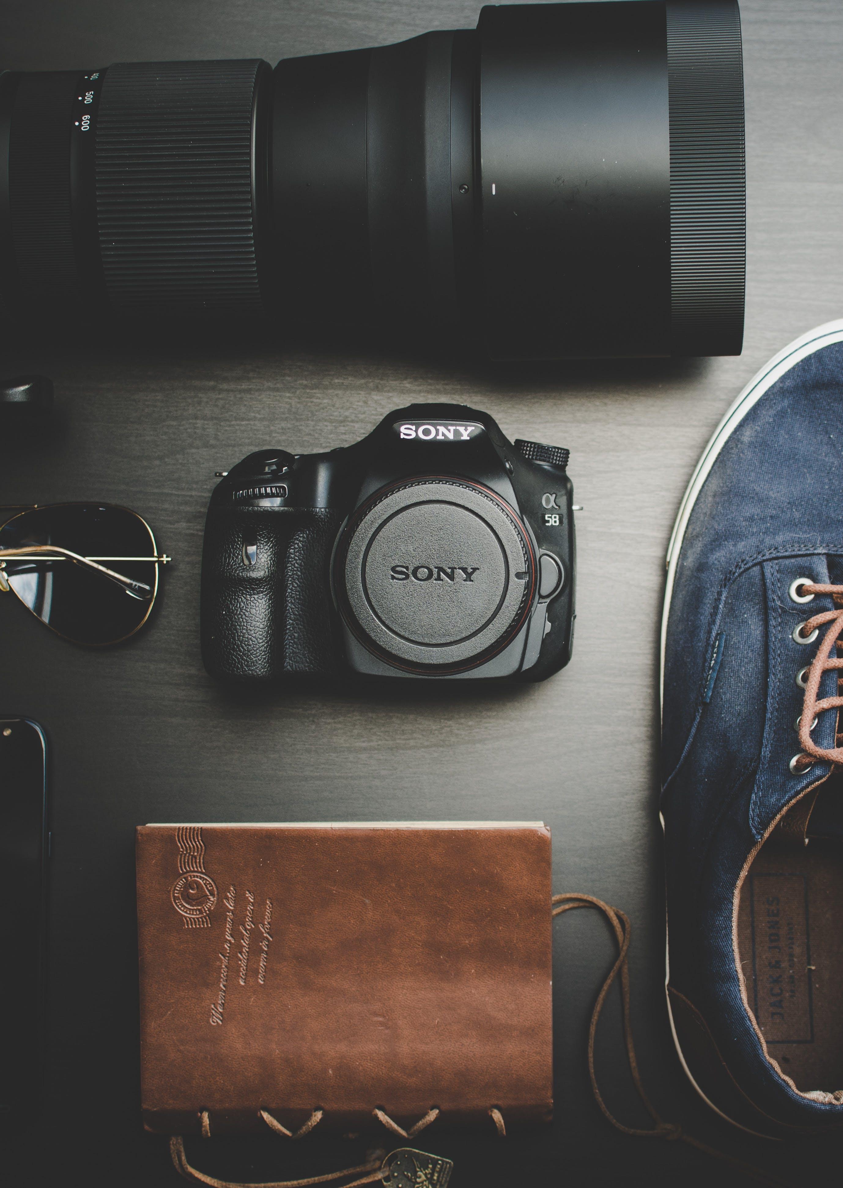 Black Sony Alpha Dslr Camera Body and Lens on Gray Surface