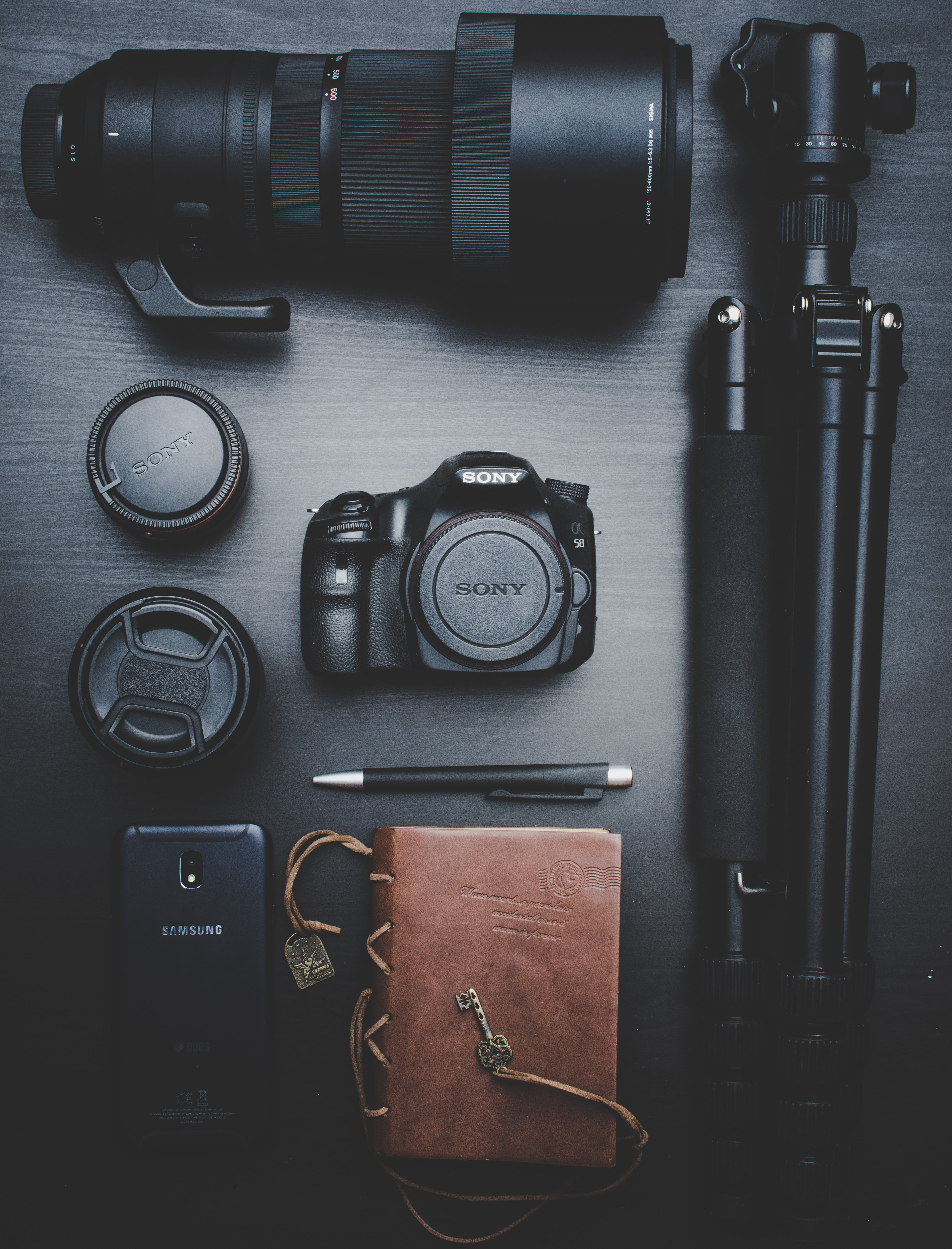 Black Sony Dslr Camera With Telephoto Lens and Tripod