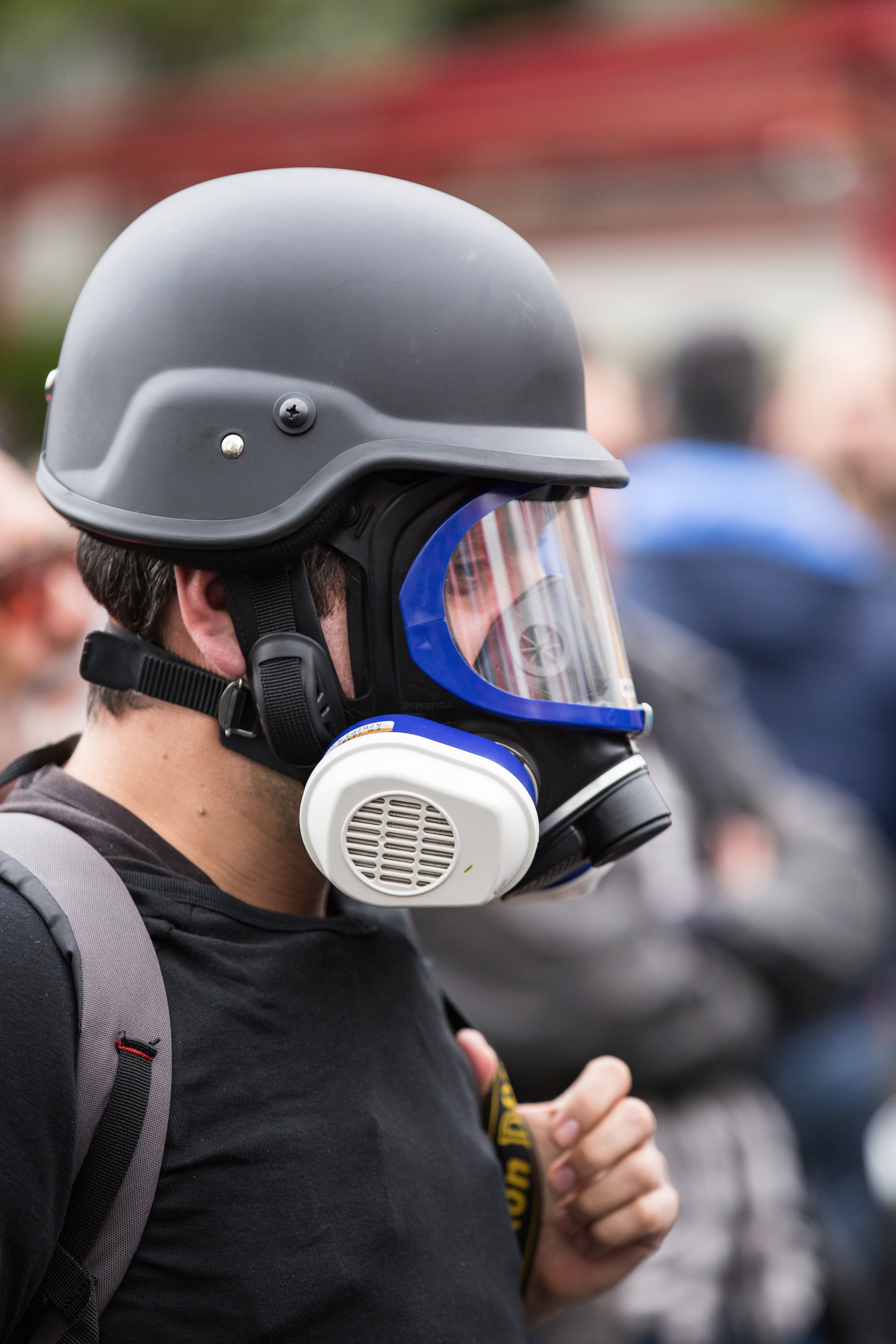 Man Wearing Black Gas Mask and Protective Helmet