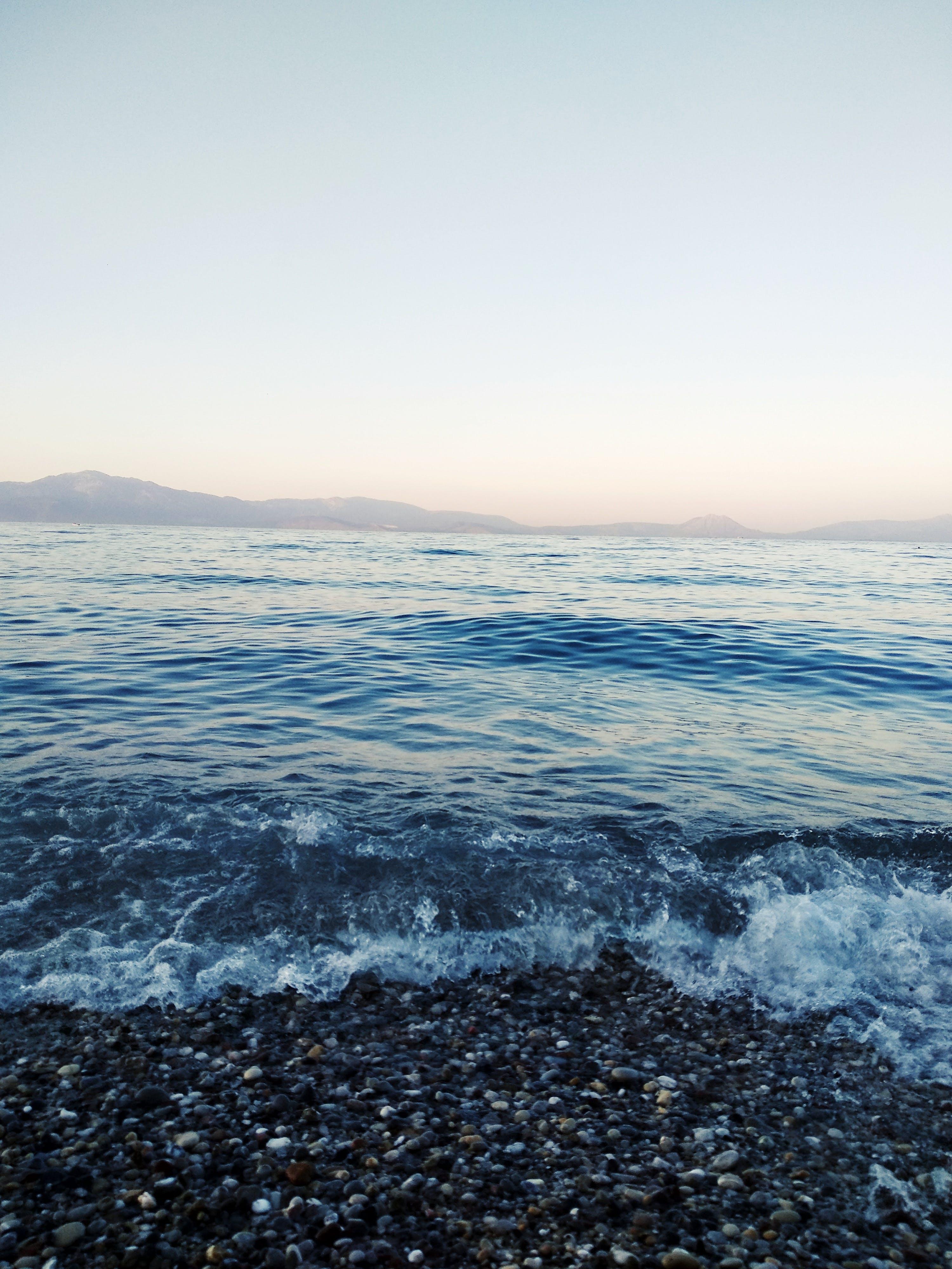 Foto profissional grátis de água, beira-mar, céu, clima