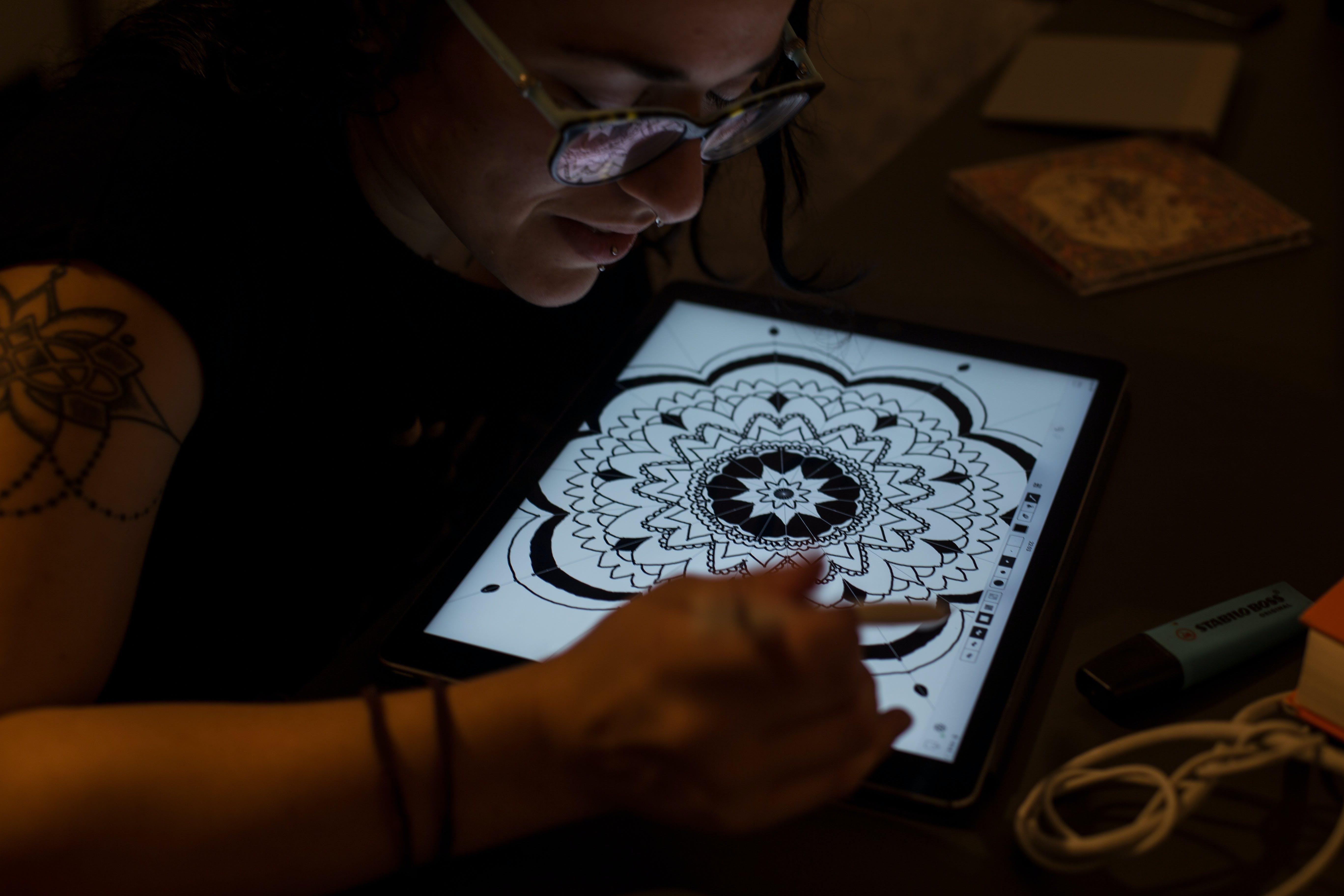 Woman Draws Mandala in Tablet Computer