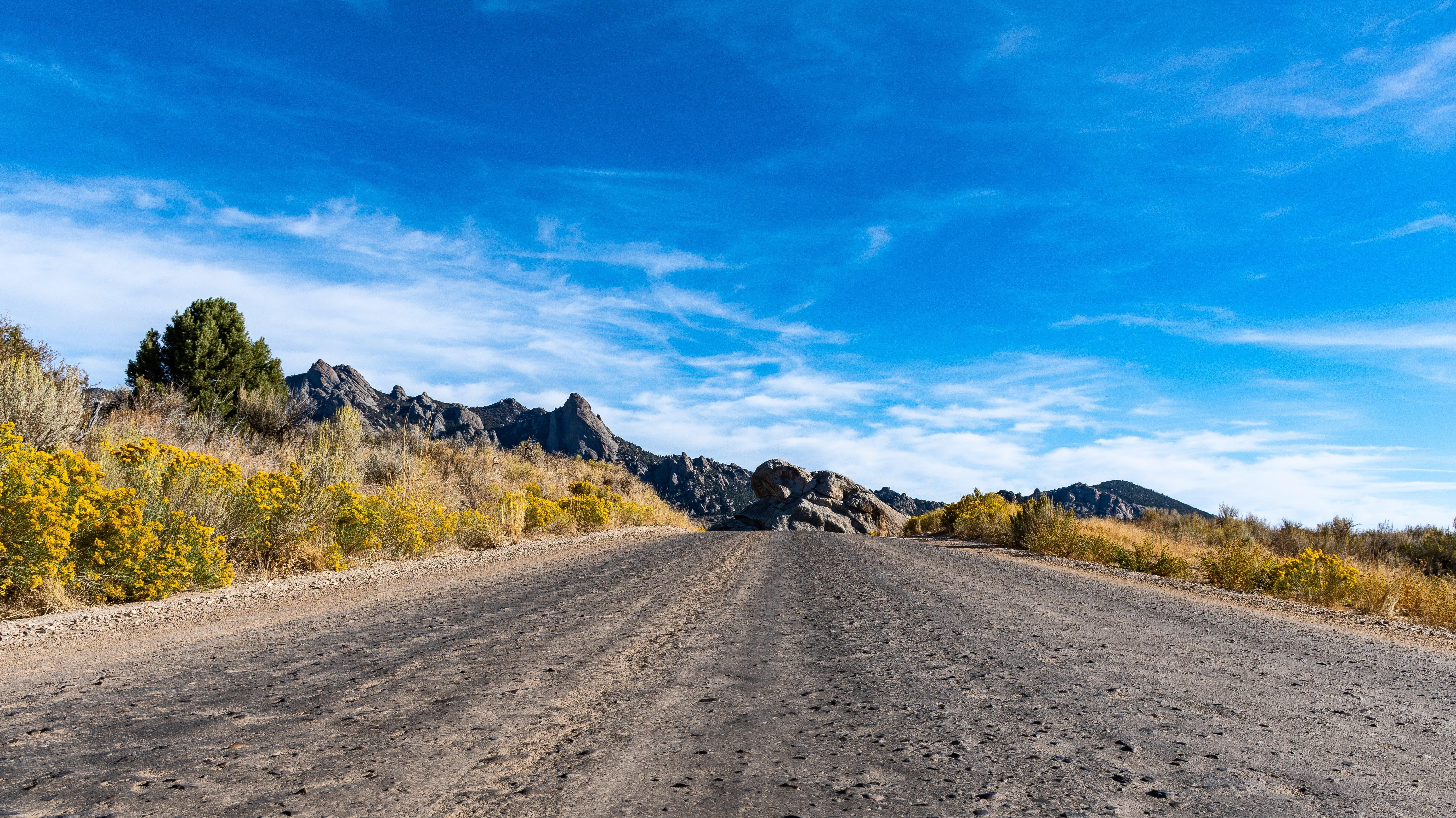 Empty Road Under Cirrus Clouds