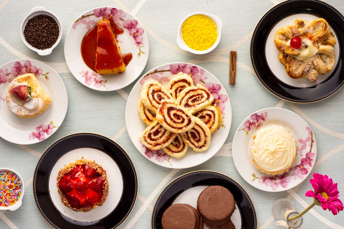 Variety of Baked and Dessert Foods on Plates