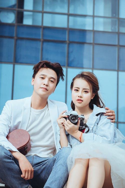 Man Beside Woman Carrying Dslr Camera