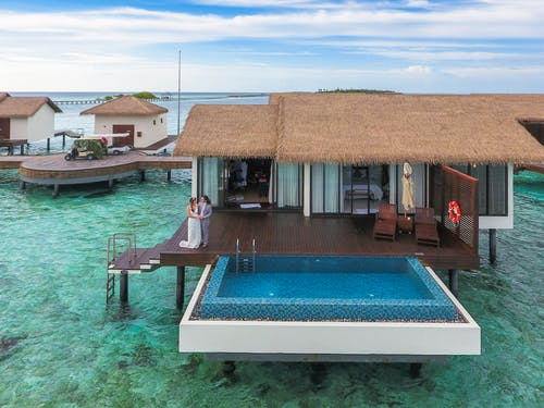 Couple Standing at Maldives Cottage