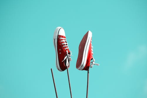 Pair of Red-and-white Low-top Sneakers