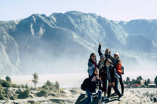 Six Girls Standing on Mountain Cliff