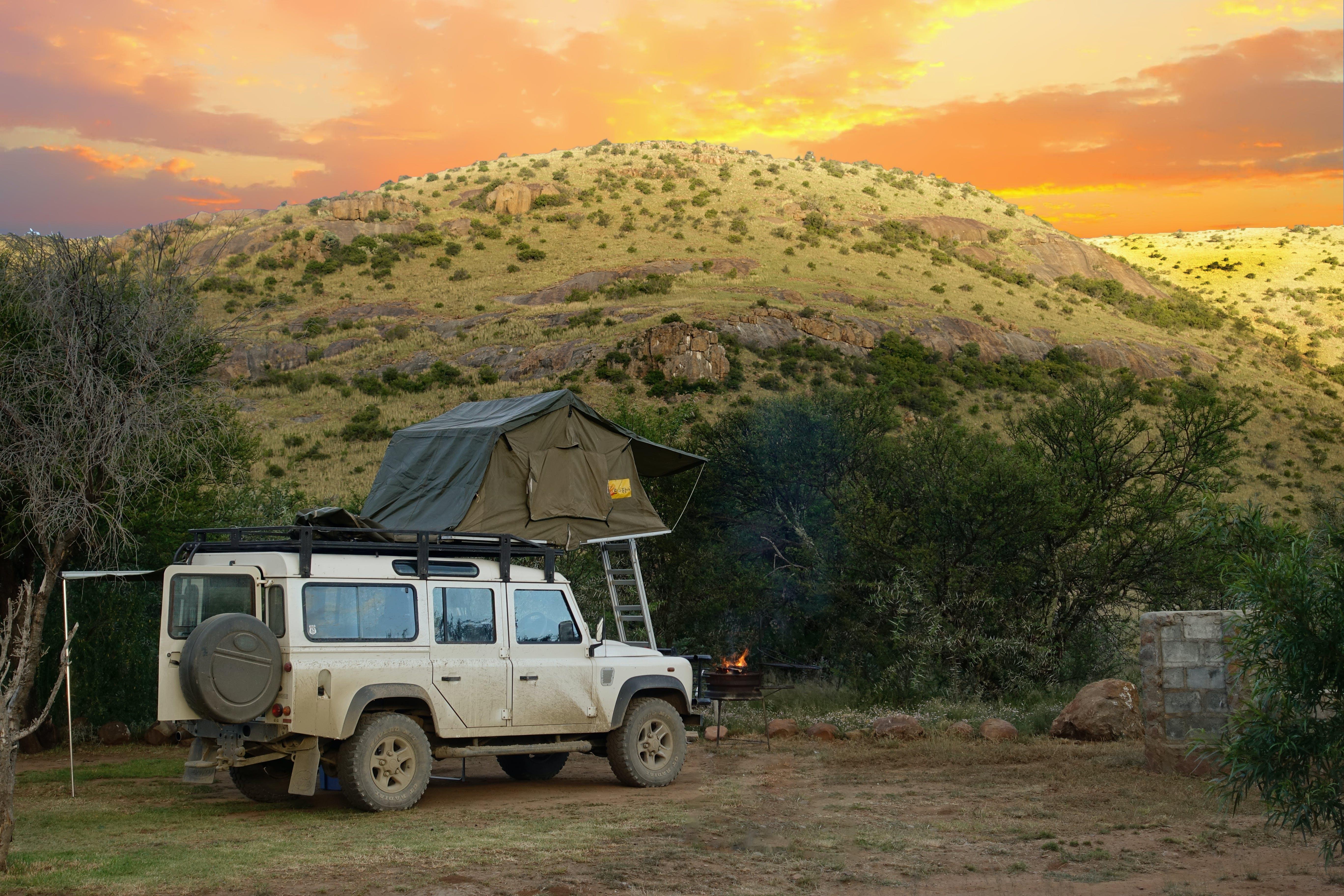 White Land Rover Defender in Jungle